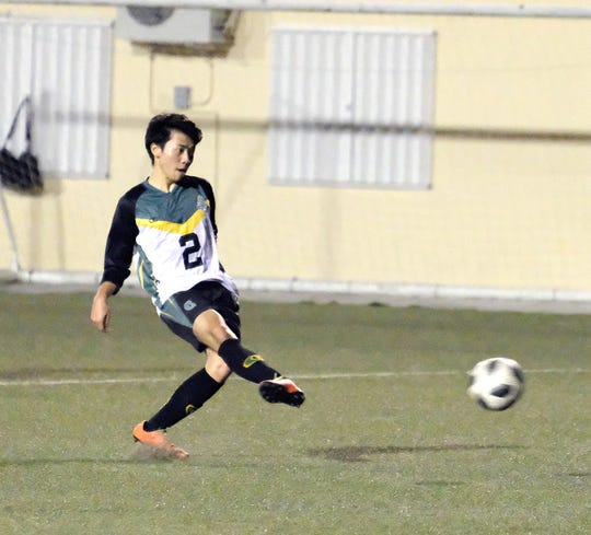 Ryoga Okada scores on penalty kick for Tritons in a 5-0 victory over the Islanders FC in the GFA Amateur Men's League.