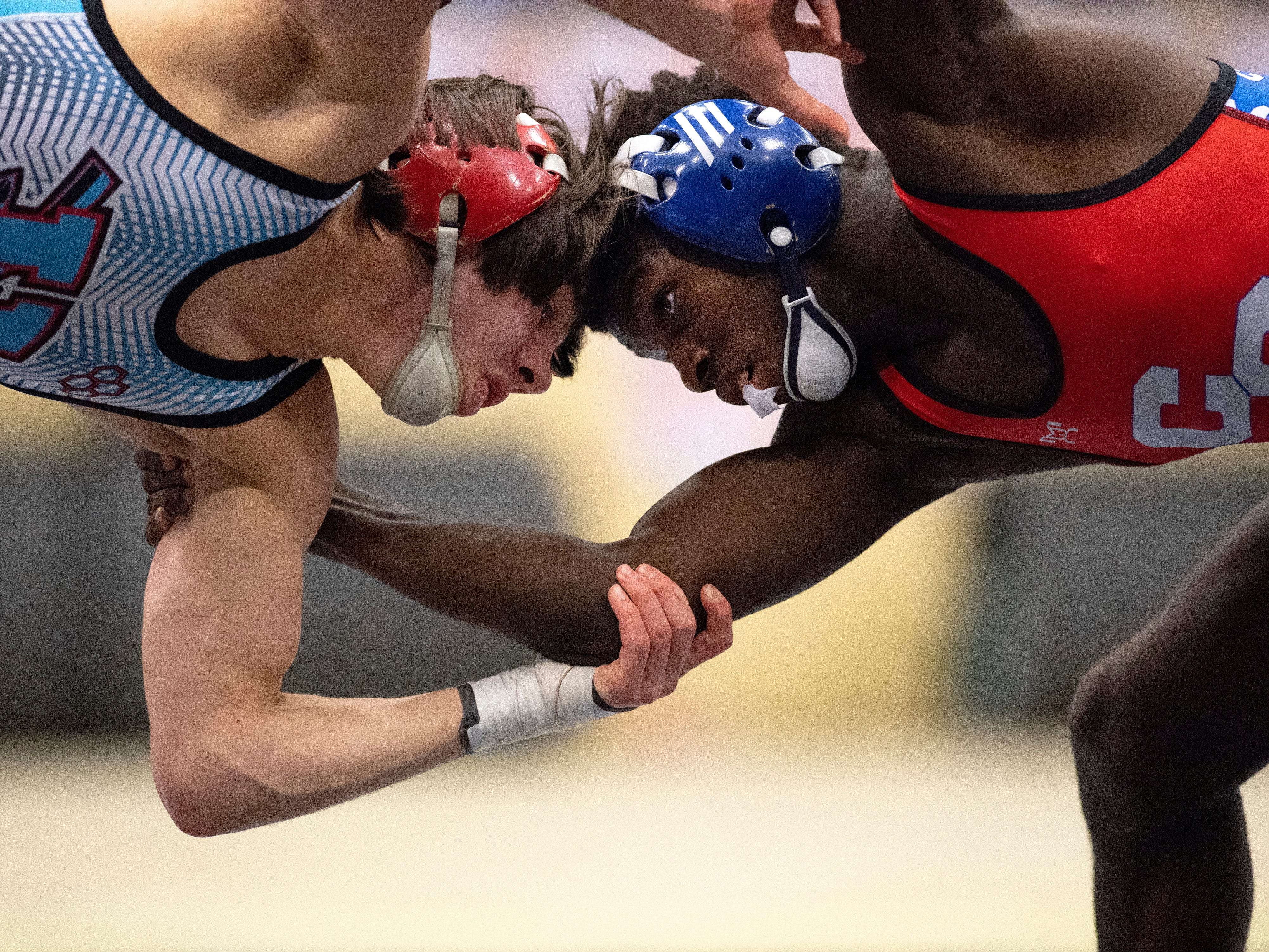 Union County's Gabe Adams competes against Christian County's Jakerion Merrittat in the 132-pound championship match the KHSAA State Wrestling Championships at the Alltech Arena in Lexington, Ky., Saturday afternoon.