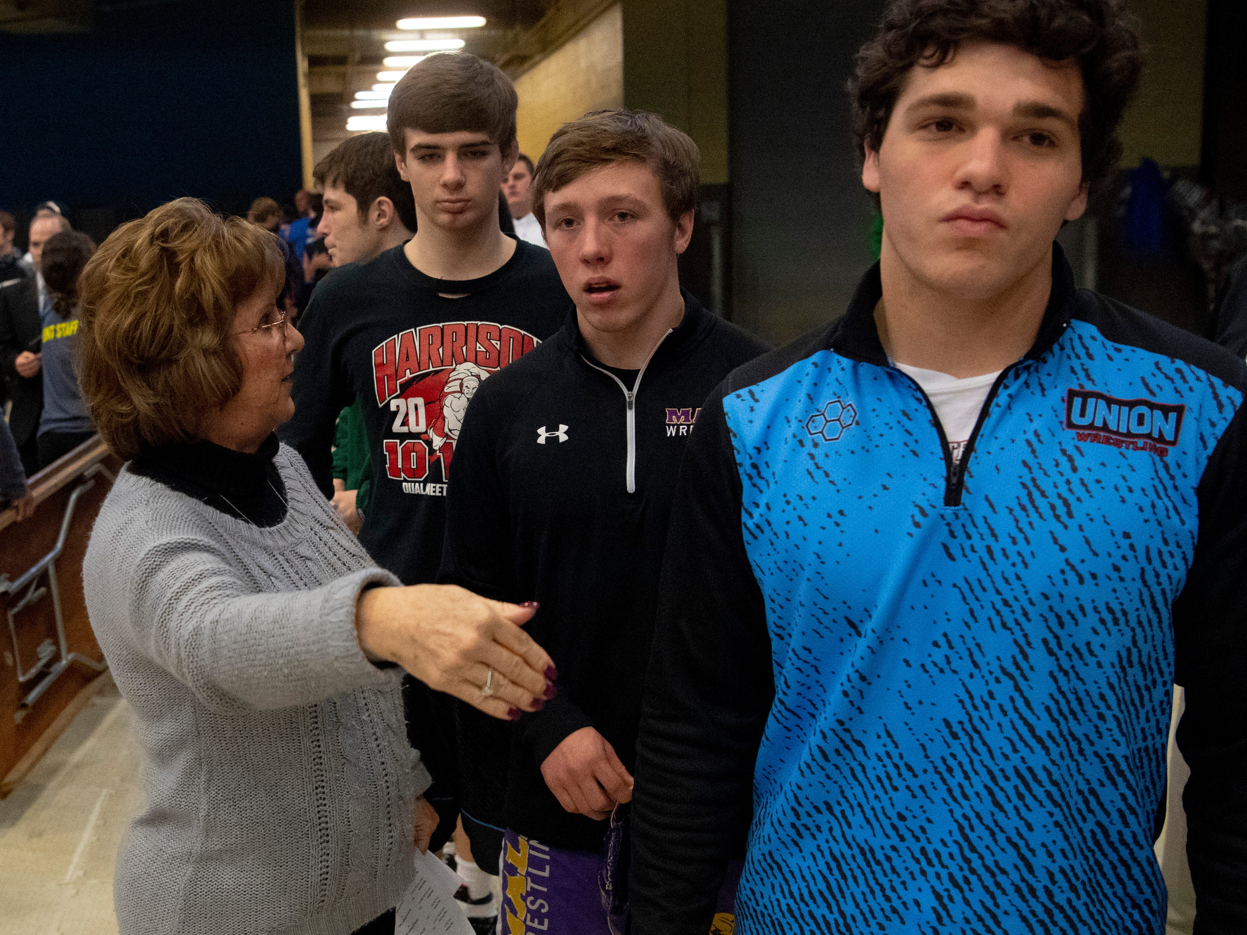Union County's Micah Ervin prepares to take the floor for introductions at the KHSAA State Wrestling Championships at the Alltech Arena in Lexington, Ky., Saturday afternoon.
