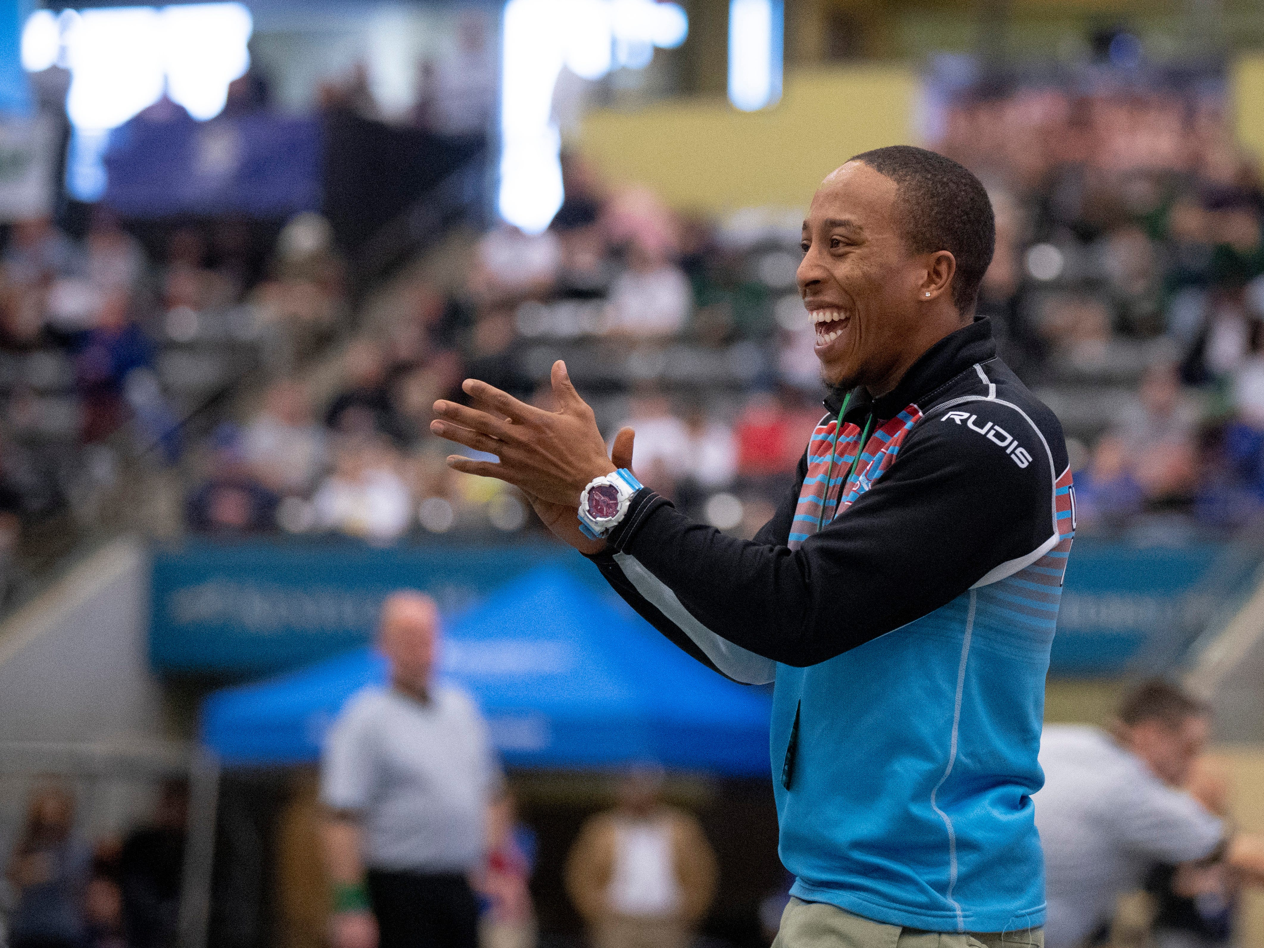 Union County coach Jarvis Elam celebrates Dalton Russelburg's 152-pound semifinal win at the KHSAA State Wrestling Championships at the Alltech Arena in Lexington, Ky., Saturday afternoon.