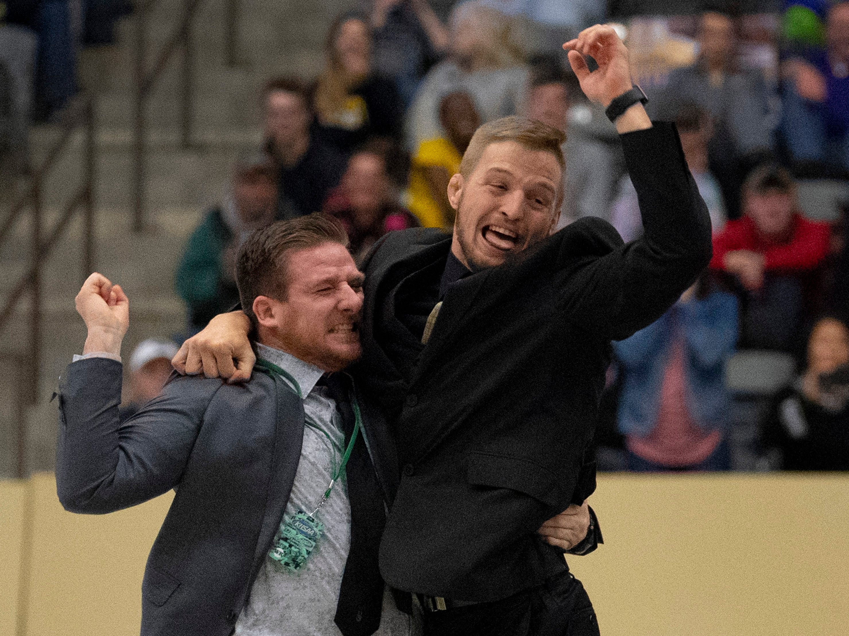 Boyle County coaches Seth Lucas, left, and Kyle Terry celebrate Jordan Bates state championship in the 138-pound category at the KHSAA State Wrestling Championships at the Alltech Arena in Lexington, Ky., Saturday night.