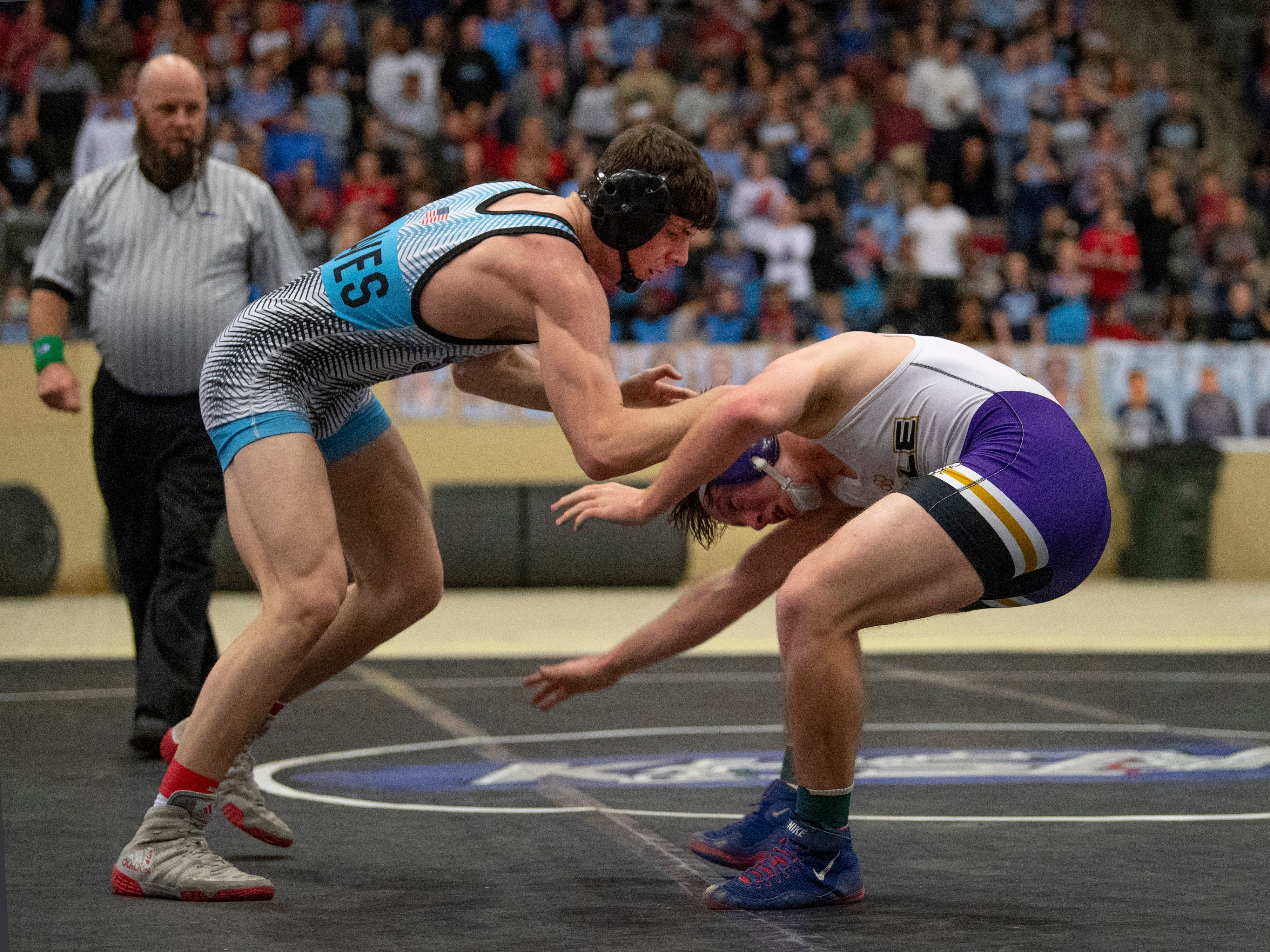 Union County's Stephen Little, left, competes against Male's Zane Brown in the 160-pound championship match at the KHSAA State Wrestling Championships at the Alltech Arena in Lexington, Ky., Saturday afternoon.