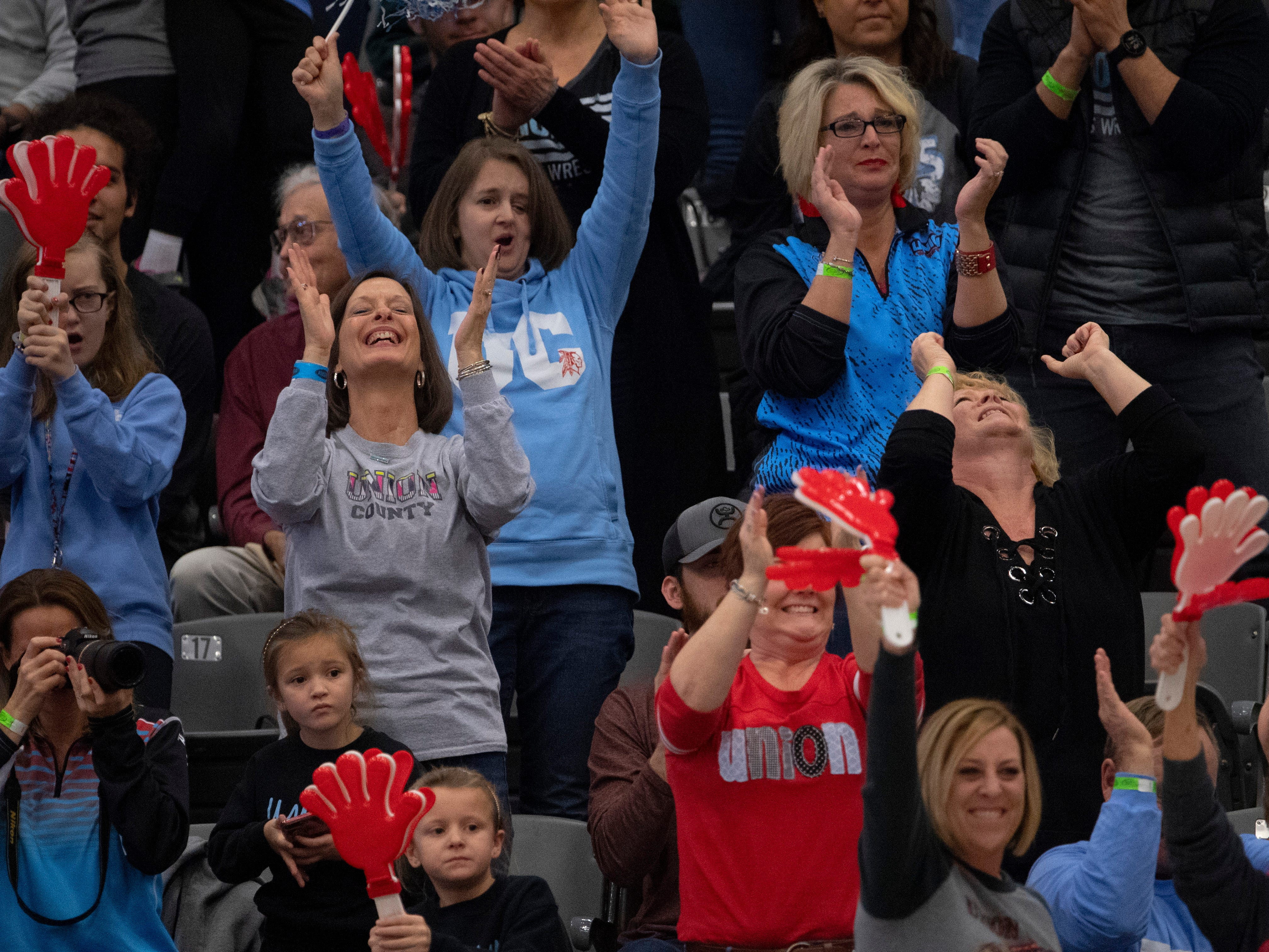 The Union County Braves fan section cheers on Trayce Eckman during his 106-pound match in his first consolation bracket match at the KHSAA State Wrestling Championships at the Alltech Arena in Lexington, Ky., Saturday afternoon. Eckman took home the third place medal for his efforts.