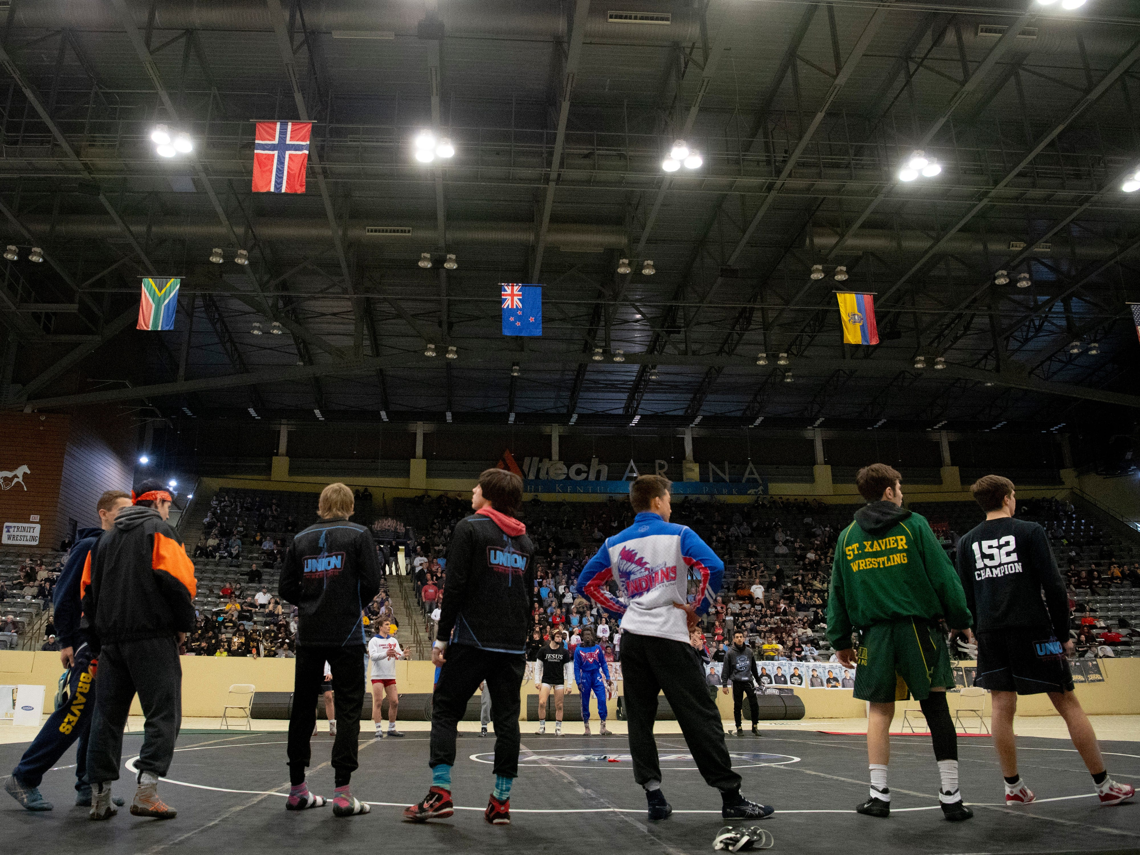 Wrestlers take to the mat for introductions at the KHSAA State Wrestling Championships at the Alltech Arena in Lexington, Ky., Saturday afternoon.