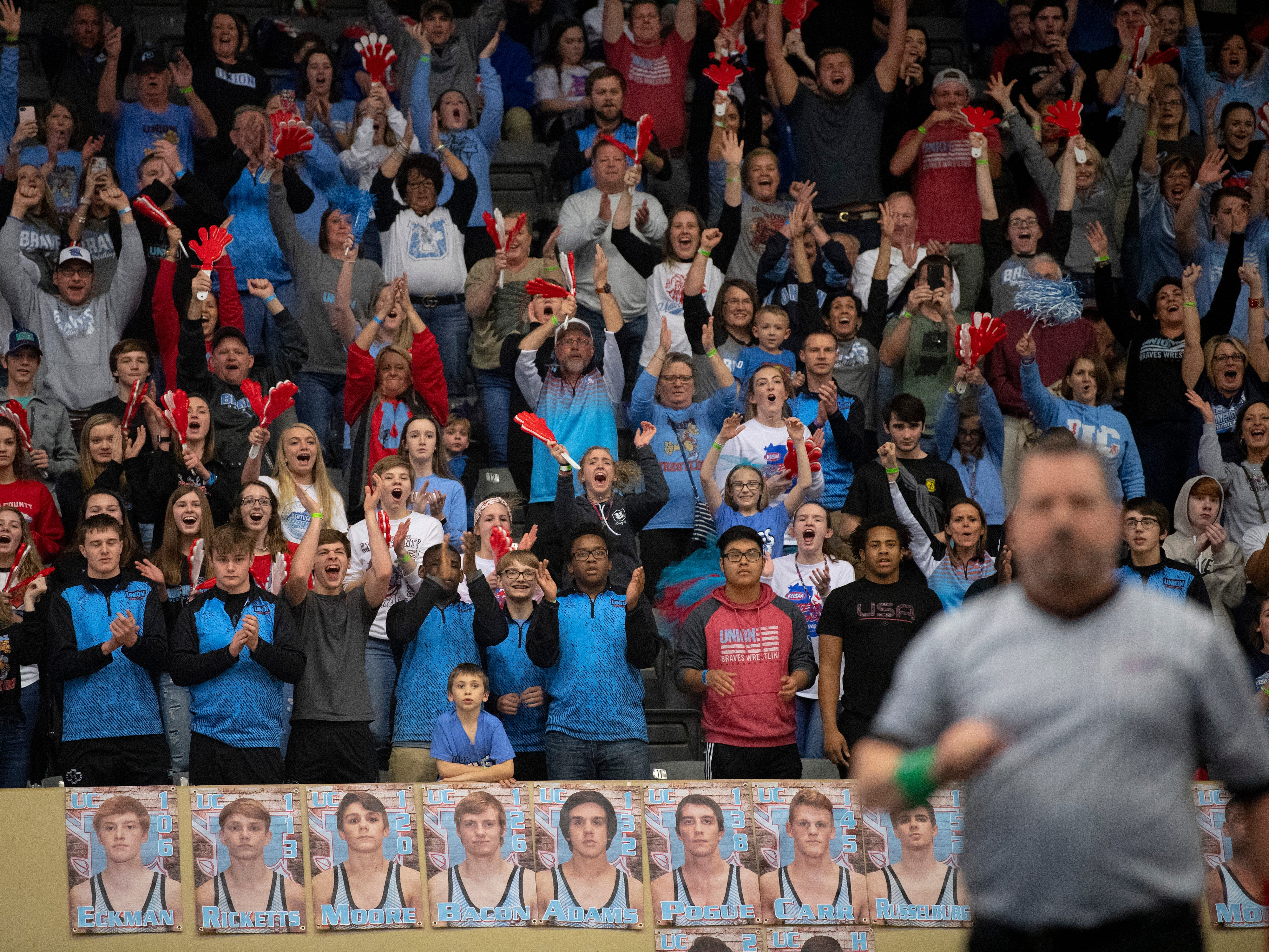 The Union County fans celebrate Mathias Ervin's 220-pound championship win at the KHSAA State Wrestling Championships at the Alltech Arena in Lexington, Ky., Saturday afternoon. Ervin defeated Christian County's Niko Bussell with a 3-1 decision for his second state championship.