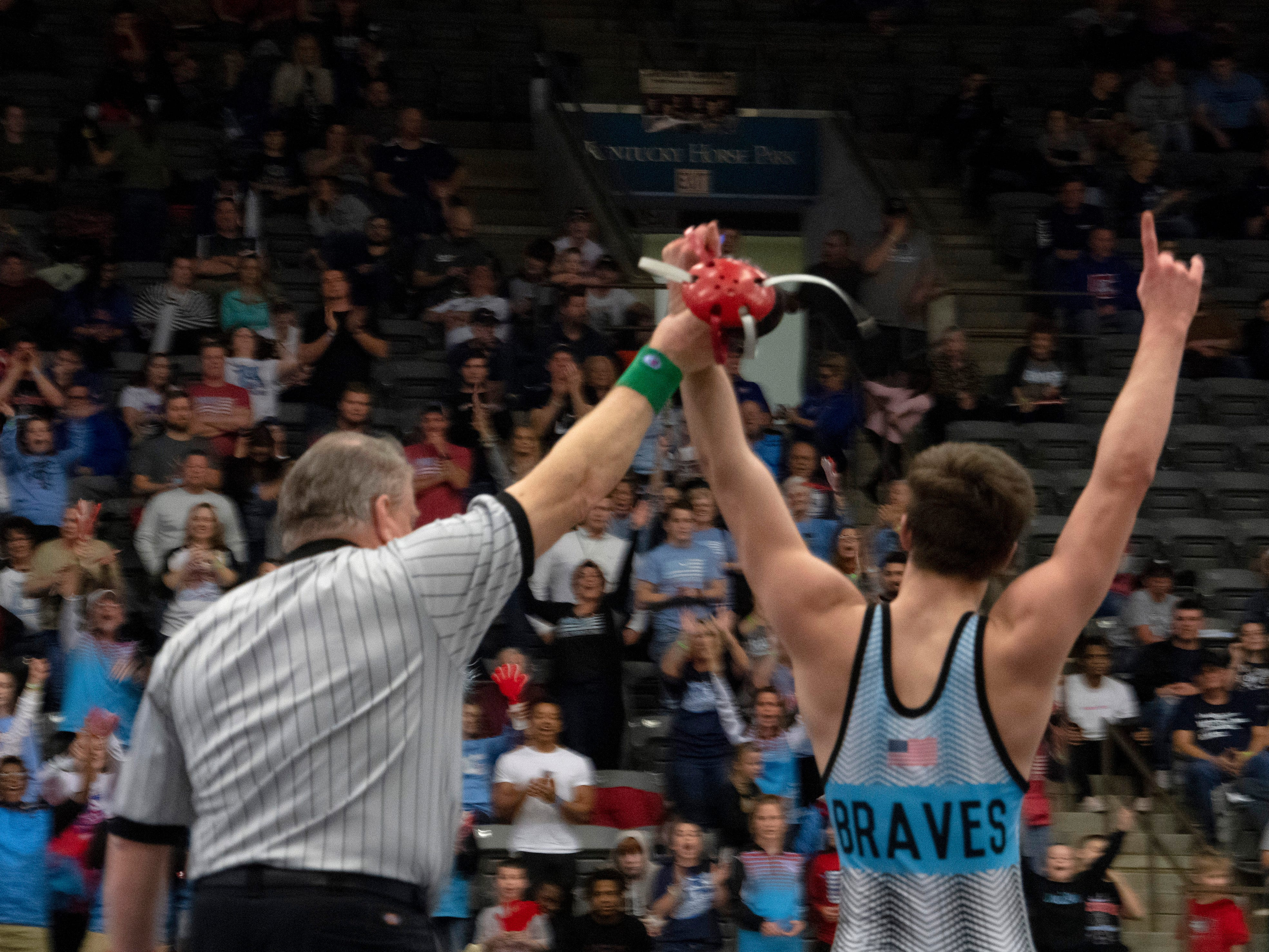 Union County's Dalton Russelburg celebrates after beathing Lafayette's Brayden Giannone for the 152-pound championship at the KHSAA State Wrestling Championships at the Alltech Arena in Lexington, Ky., Saturday afternoon.