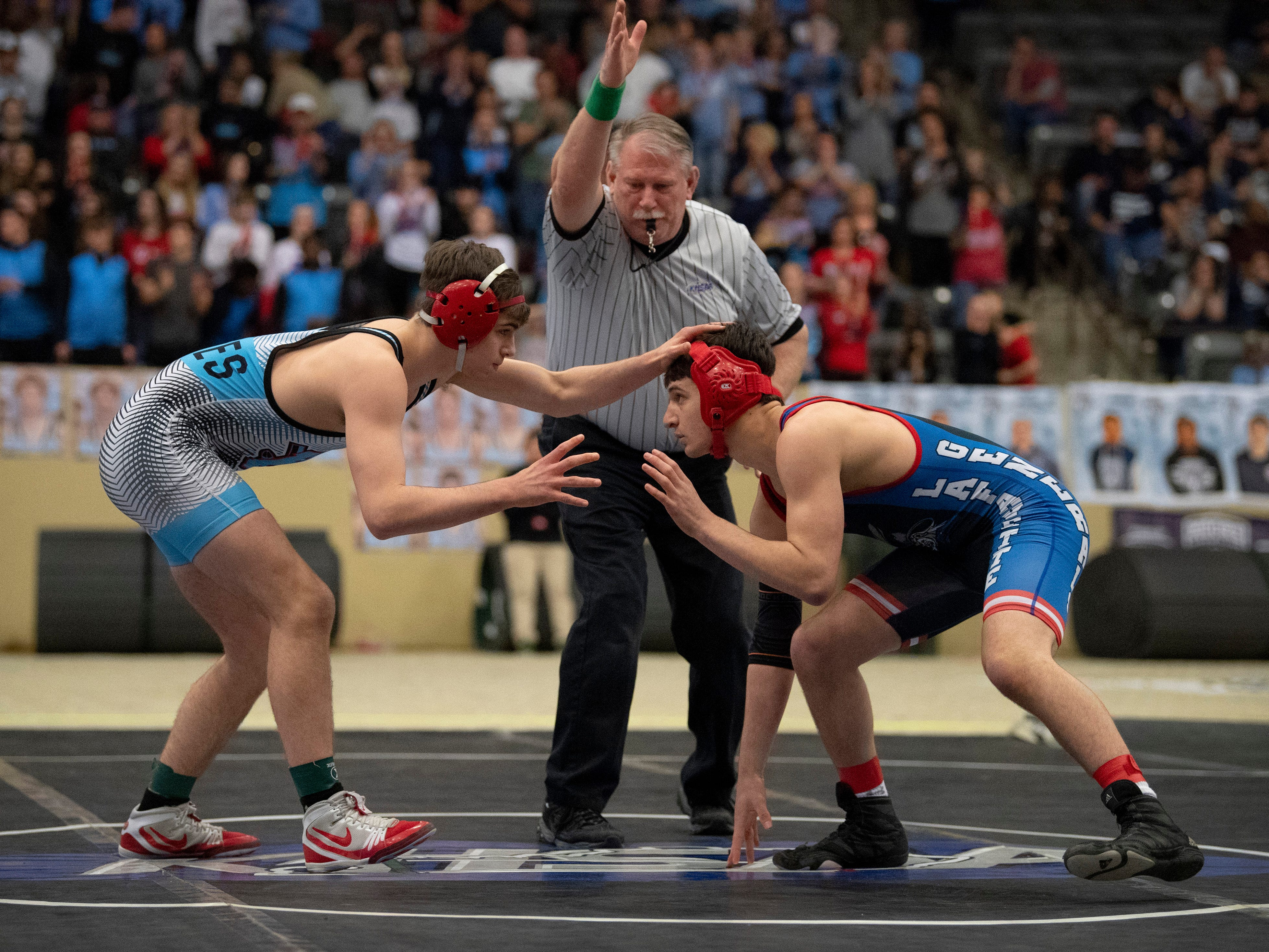 Union County's Dalton Russelburg, left, competes against Lafayette's Brayden Giannone for the 152-pound championship at the KHSAA State Wrestling Championships at the Alltech Arena in Lexington, Ky., Saturday afternoon.