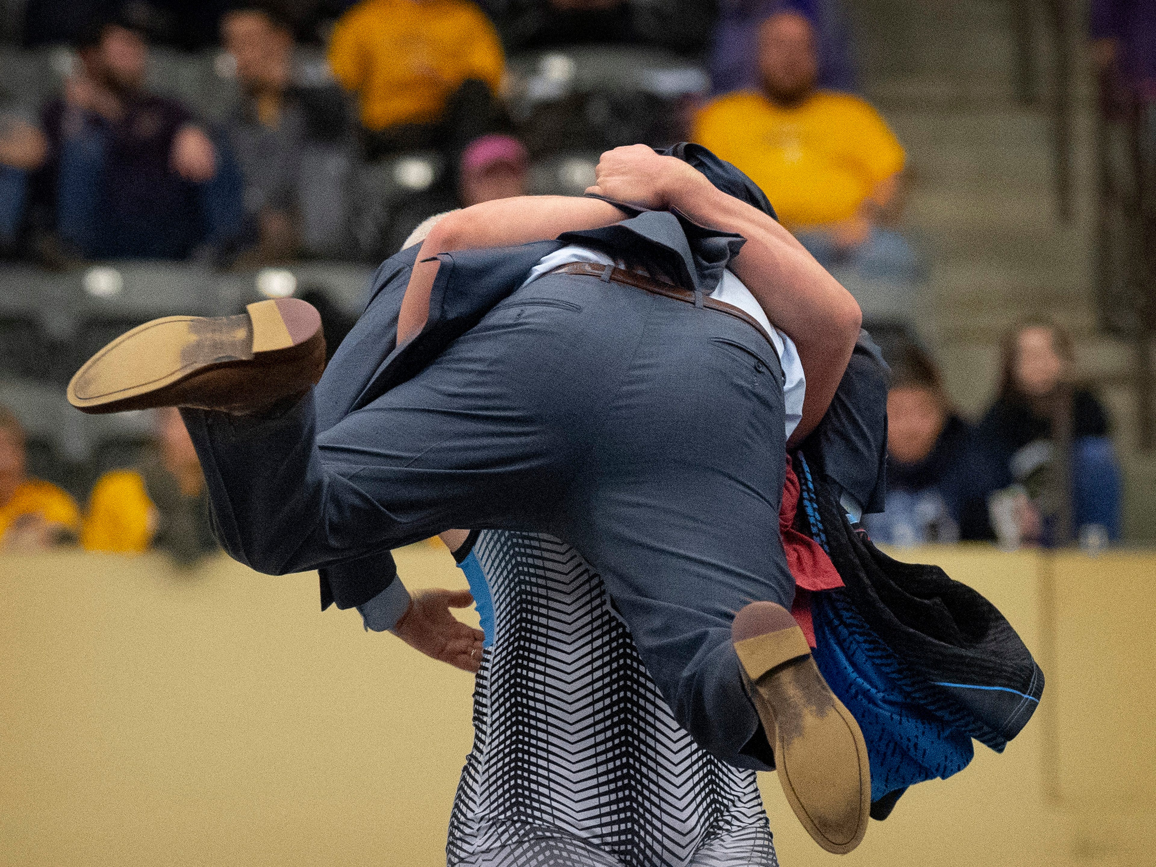 Union County head coach (and dad) Robert Ervin is lifted into the air by his son, Mathias Ervin, after winning the 220-pound championship match at the KHSAA State Wrestling Championships at the Alltech Arena in Lexington, Ky., Saturday afternoon. Ervin defeated Christian County's Niko Bussell with a 3-1 decision for his second state championship.