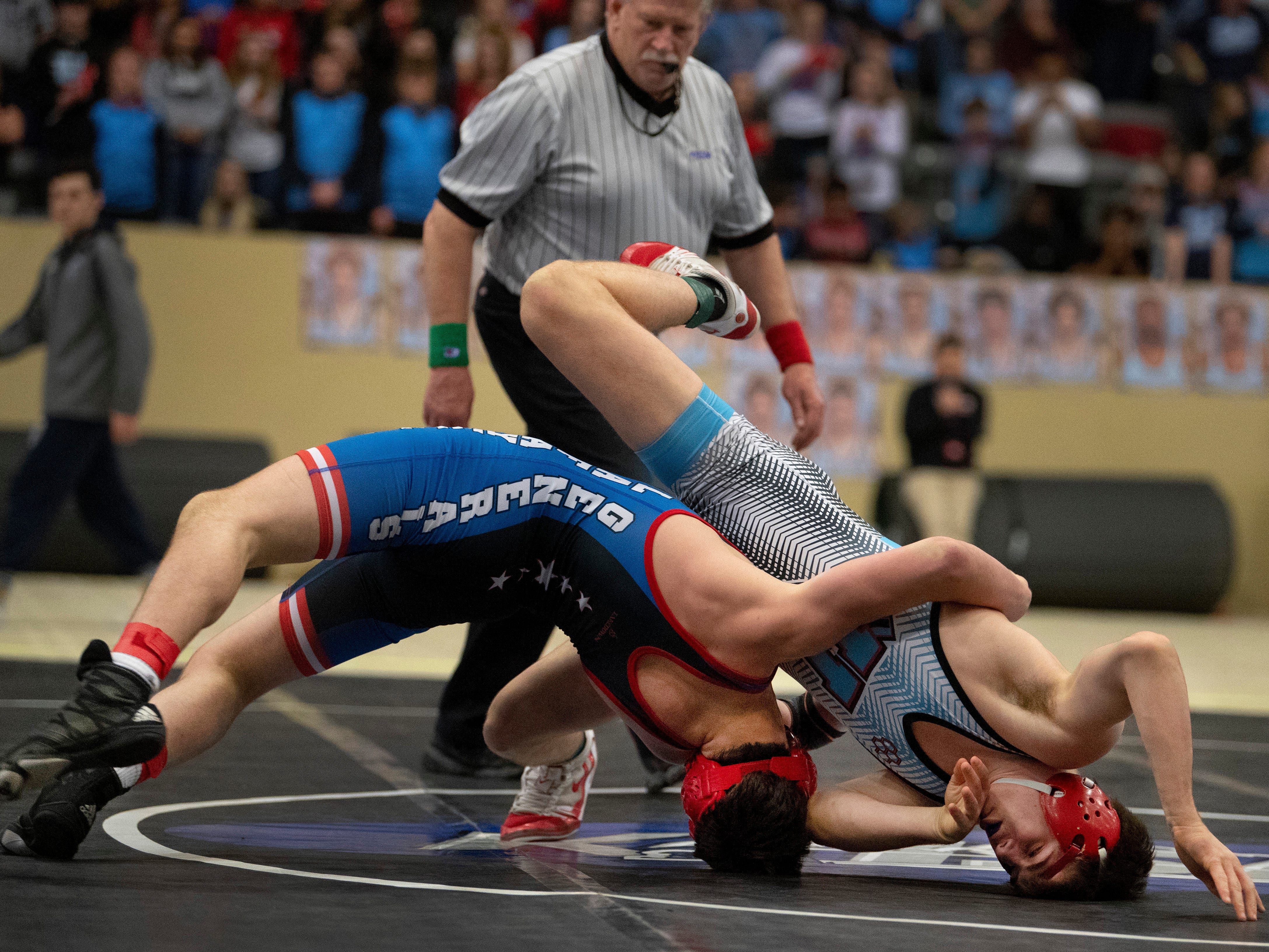 Union County's Dalton Russelburg, right, competes against Lafayette's Brayden Giannone for the 152-pound championship at the KHSAA State Wrestling Championships at the Alltech Arena in Lexington, Ky., Saturday afternoon.