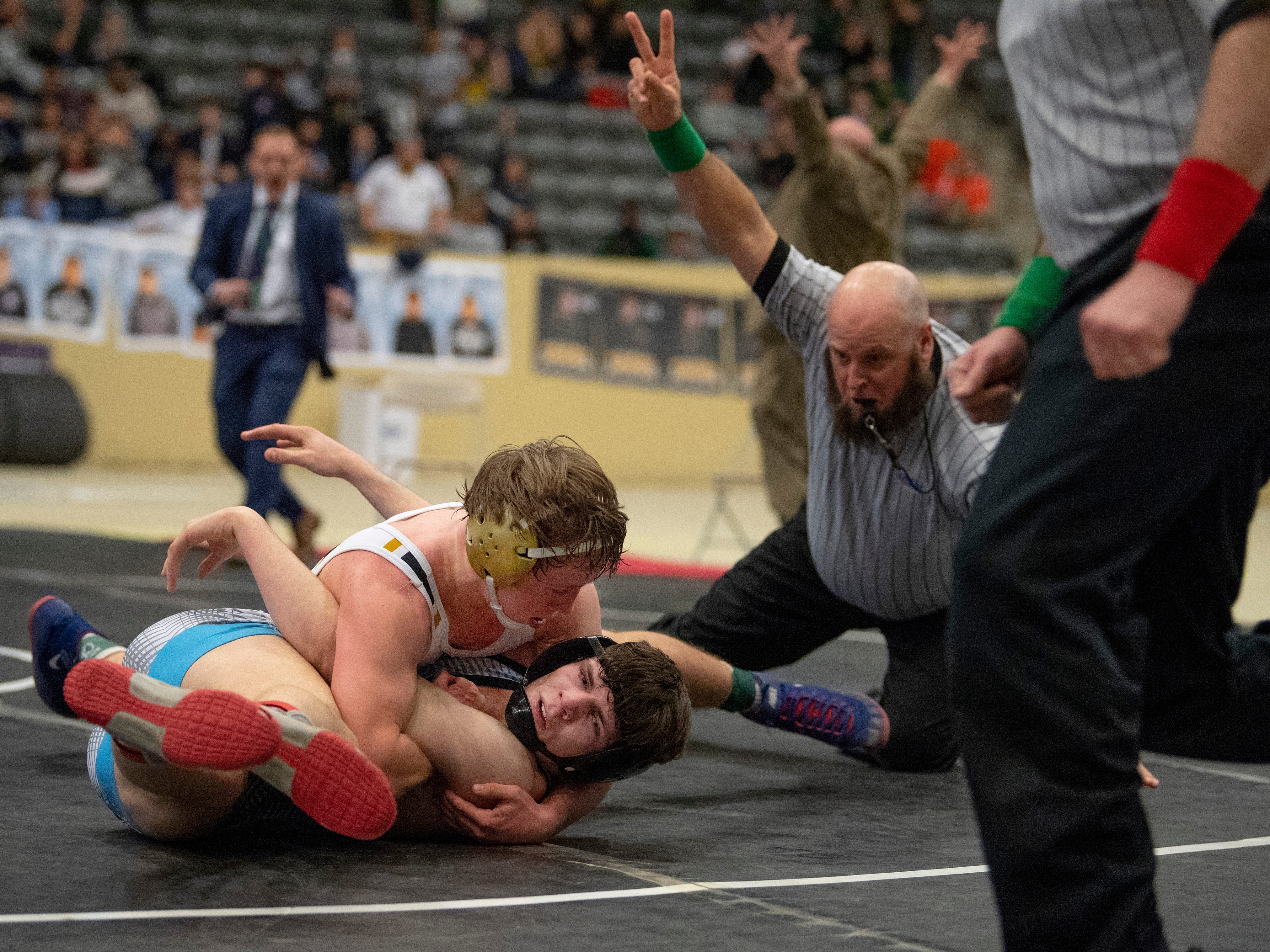 Male's Zane Brown pins Union County's Stephen Little at the 5:32 mark of their 160-pound championship match at the KHSAA State Wrestling Championships at the Alltech Arena in Lexington, Ky., Saturday afternoon.
