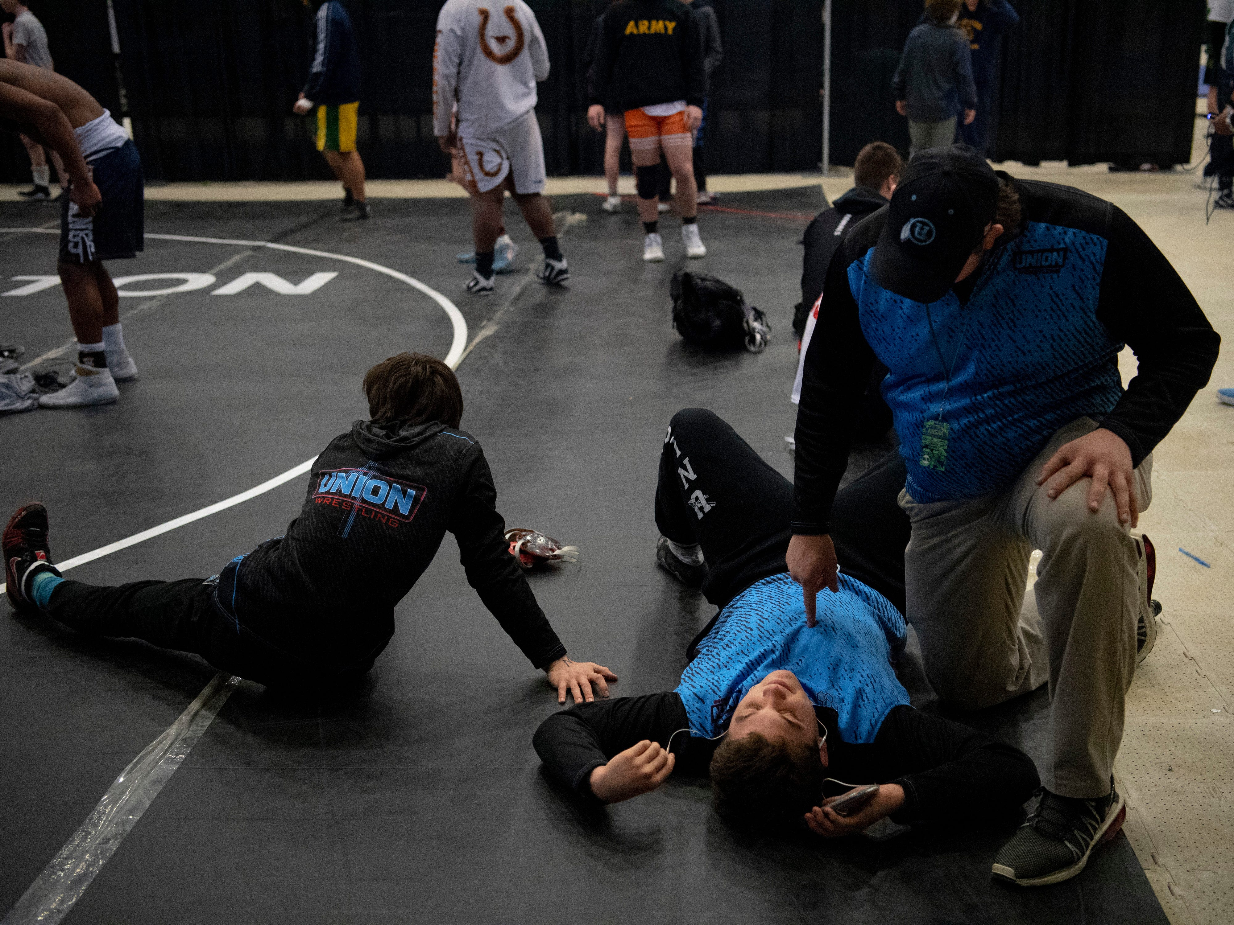 Union County coach Brooks Black, right, has a few words of encouragement for Mathias Ervin before his 220 pound semifinal match at the KHSAA State Wrestling Championships at the Alltech Arena in Lexington, Ky., Saturday afternoon.