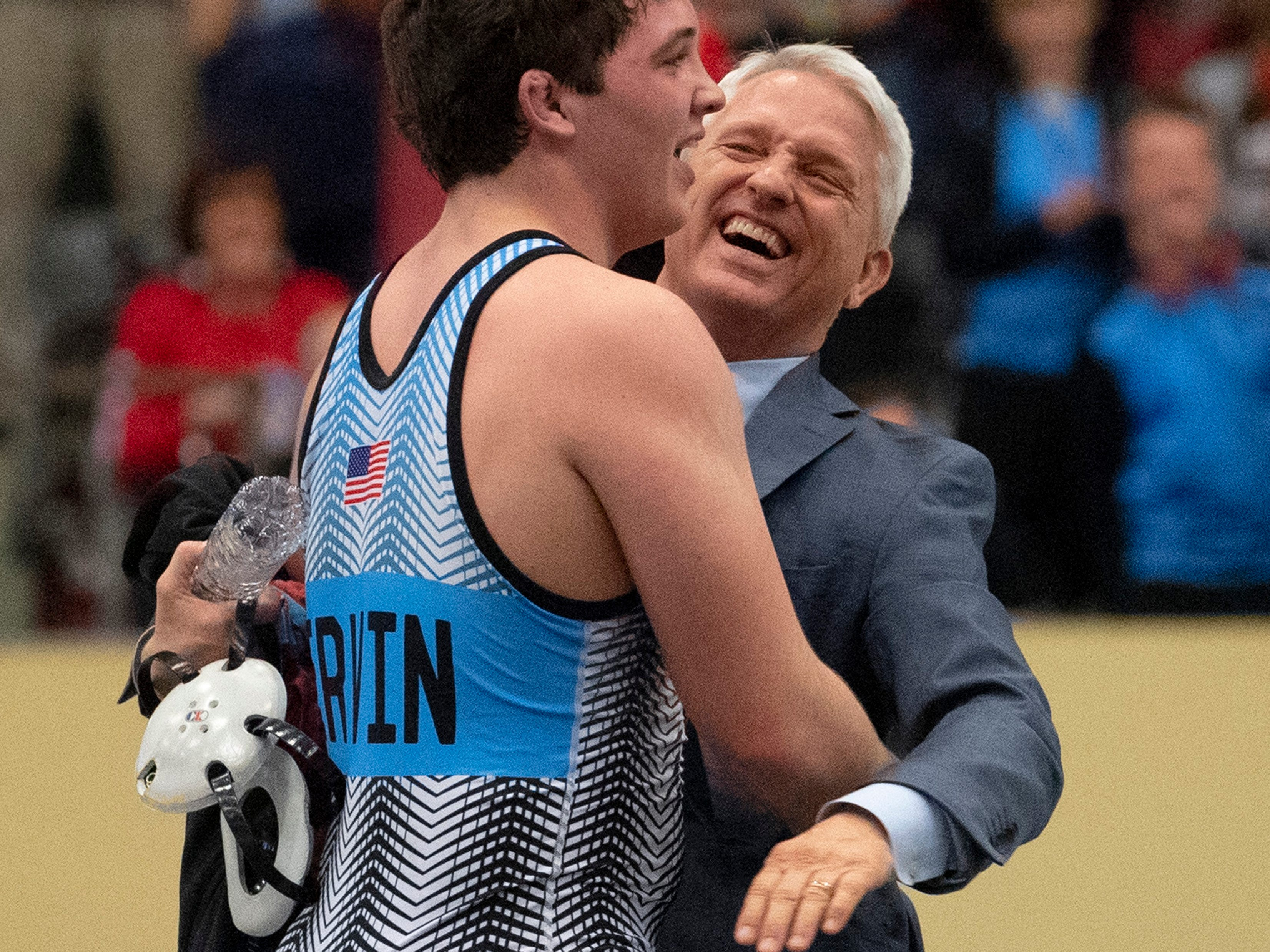 Union County head coach (and dad) Robert Ervin and his son, Mathias Ervin, celebrate after Mathias won the 220-pound championship match at the KHSAA State Wrestling Championships at the Alltech Arena in Lexington, Ky., Saturday afternoon. Ervin defeated Christian County's Niko Bussell with a 3-1 decision for his second state championship.