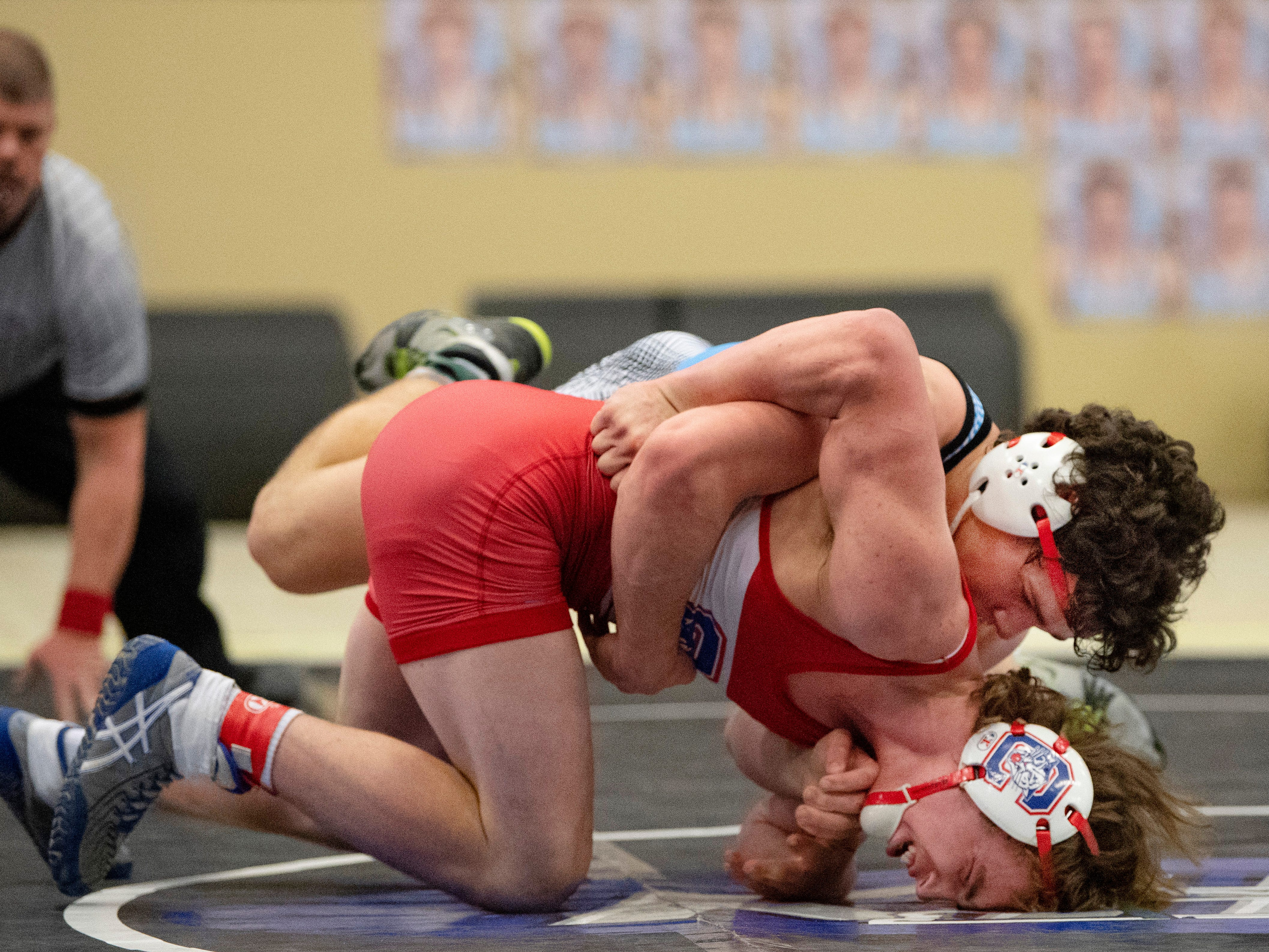 Union County's Micah Ervin, top, competes with Conner's Clayton Boyd during their 170-pound championship match at the KHSAA State Wrestling Championships at the Alltech Arena in Lexington, Ky., Saturday afternoon. Ervin won the match with a 5-3 decision to take home the state championship.