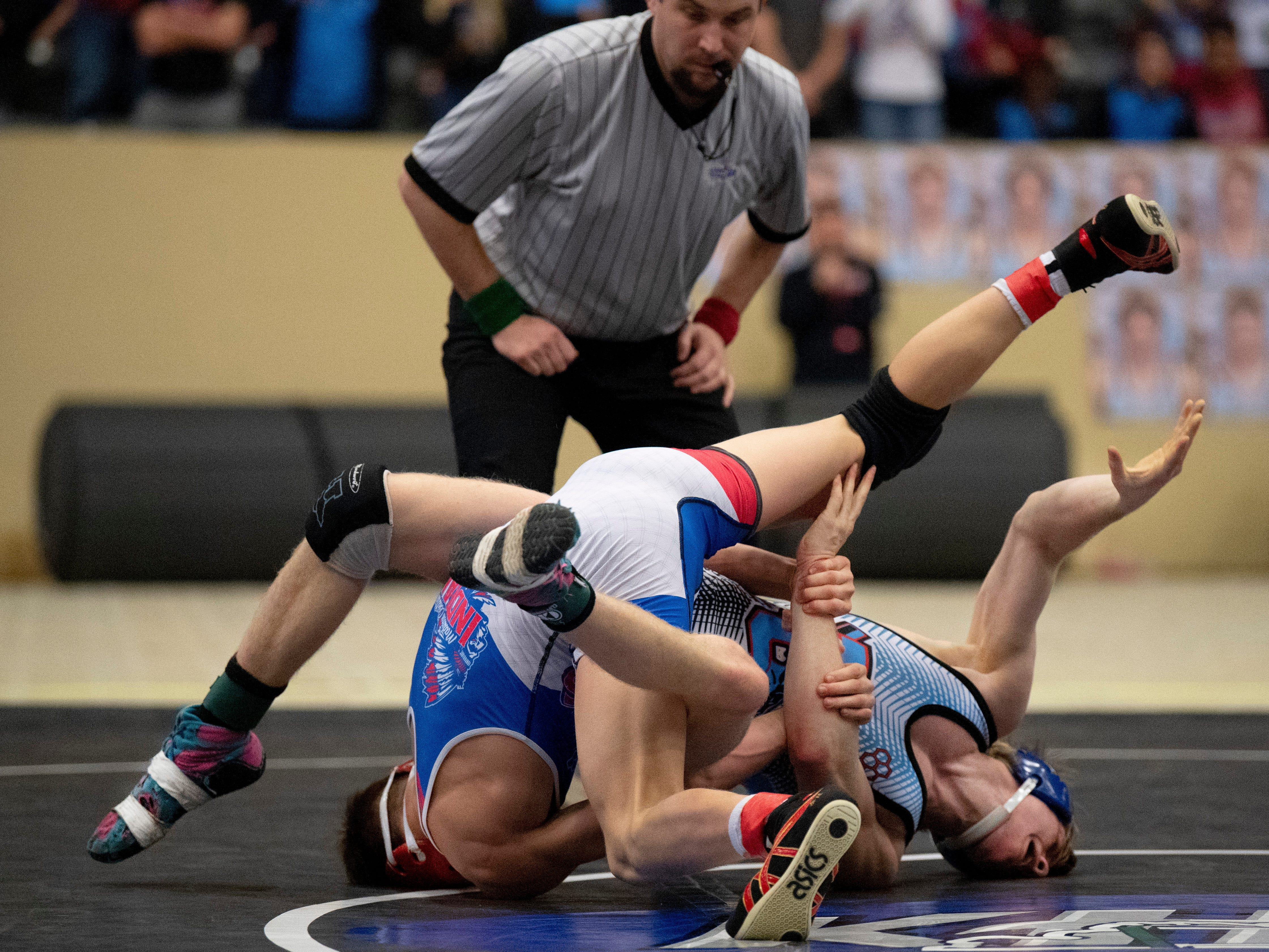 Union County's Sam Bacon, right, and Madison Central's Thomas Deck compete in 126-pound championship match  at the KHSAA State Wrestling Championships at the Alltech Arena in Lexington, Ky., Saturday afternoon.
