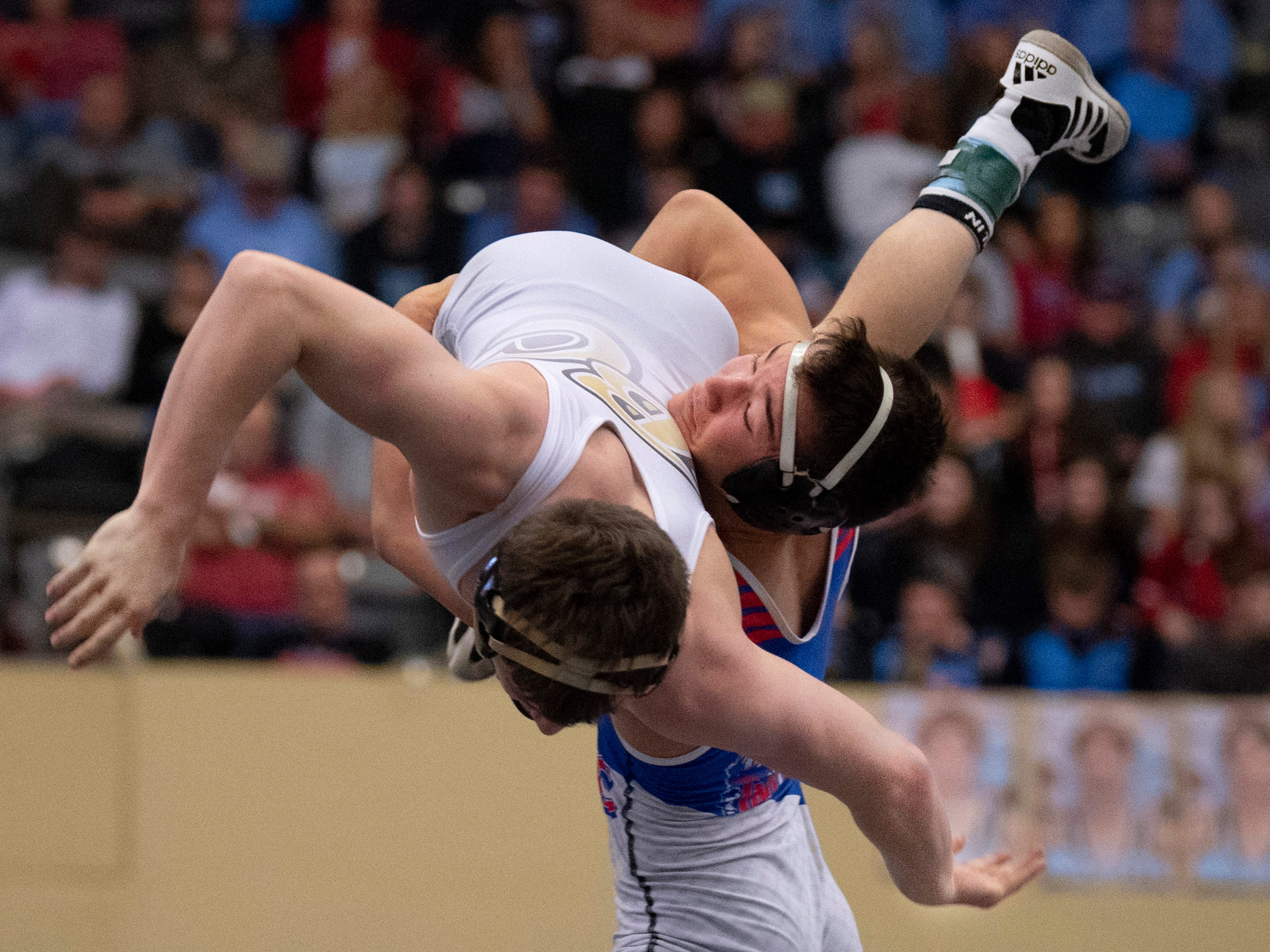 Madison Central's Gentry Deck takes down Boyle County's Jordan Bates during their 138-pound championship match at the KHSAA State Wrestling Championships at the Alltech Arena in Lexington, Ky., Saturday night. Bates came out on top with a 6-5 decision.