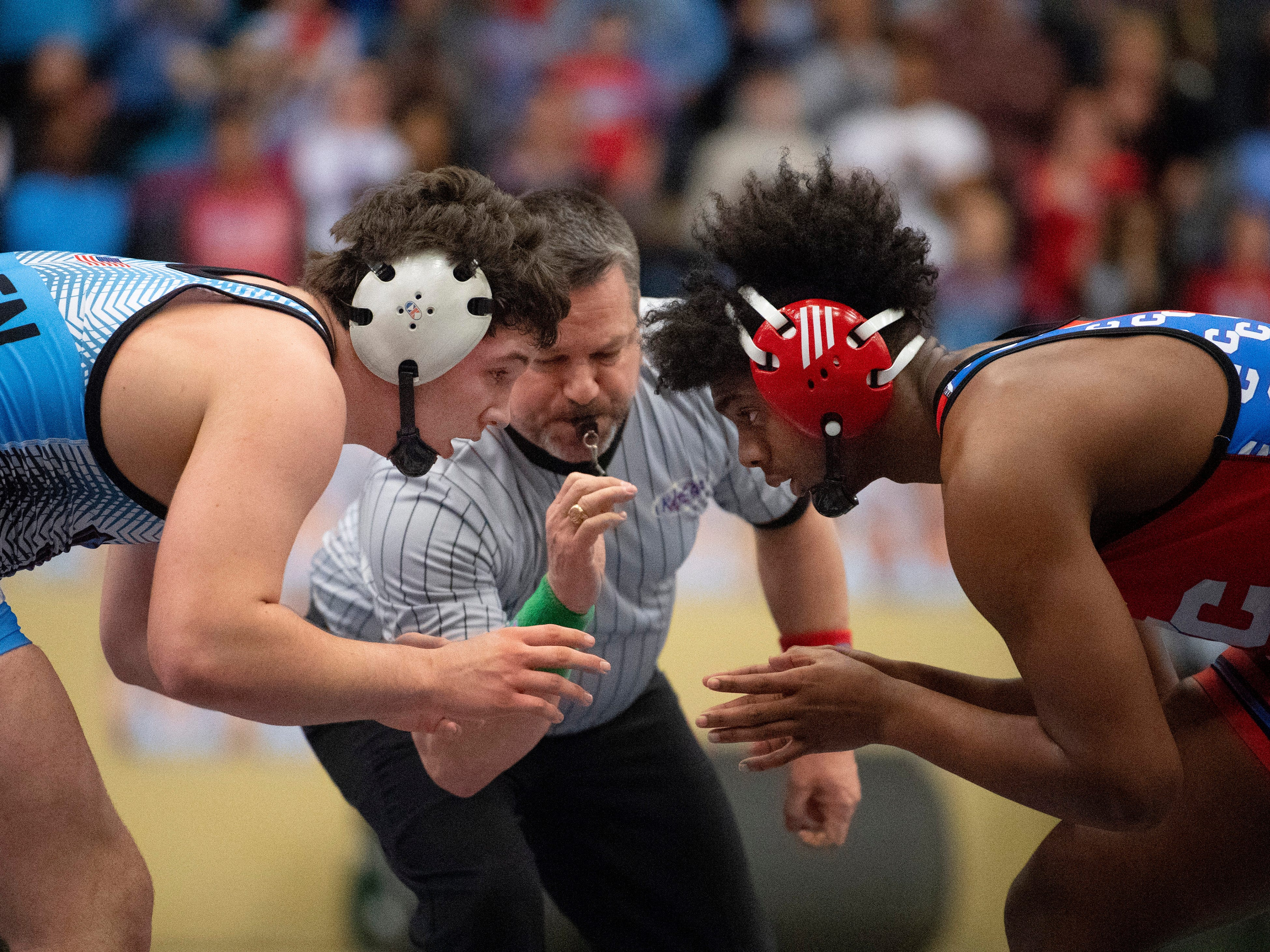 Union County's Mathias Ervin, top, competes against Christian County's Niko Bussell during the 220-pound championship match at the KHSAA State Wrestling Championships at the Alltech Arena in Lexington, Ky., Saturday afternoon. Ervin defeated Bussell with a 3-1 decision for his second state championship.
