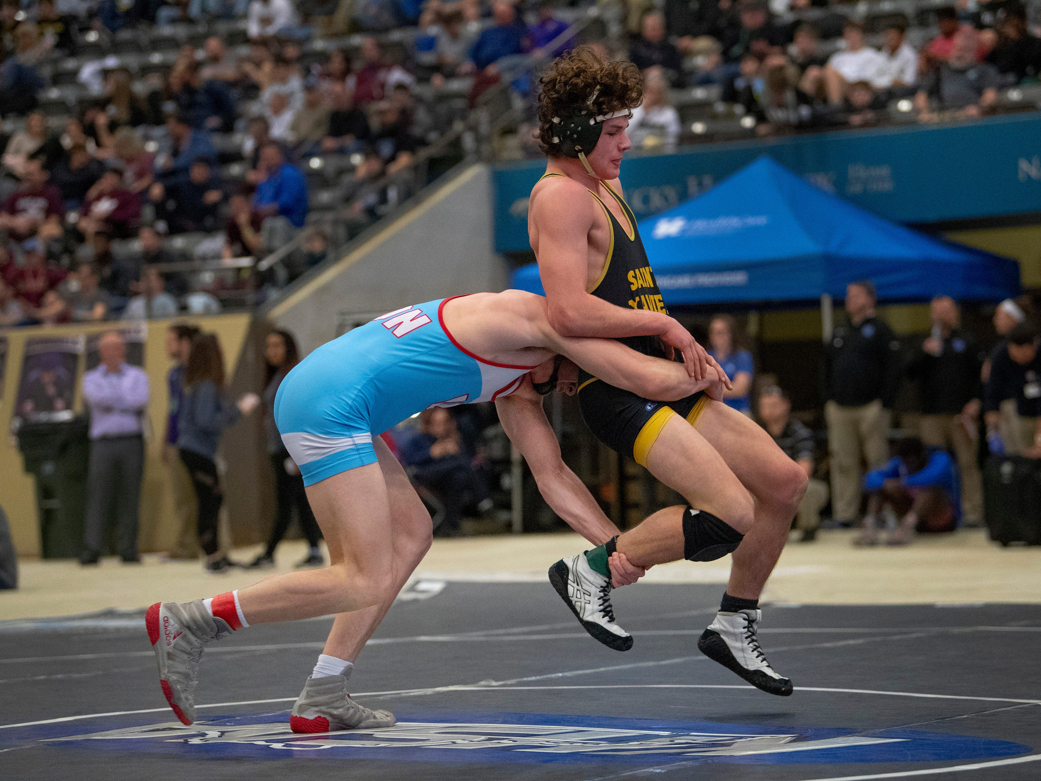 Union County's Dalton Russelburg, left, takes down  Campbell County's Thomas Ketchen-Cart in the 152-pound semifinal match at the KHSAA State Wrestling Championships at the Alltech Arena in Lexington, Ky., Saturday afternoon. Russeslburg won the match by a 7-3 decision and then went on to win the state championship with a 10-4 decision.