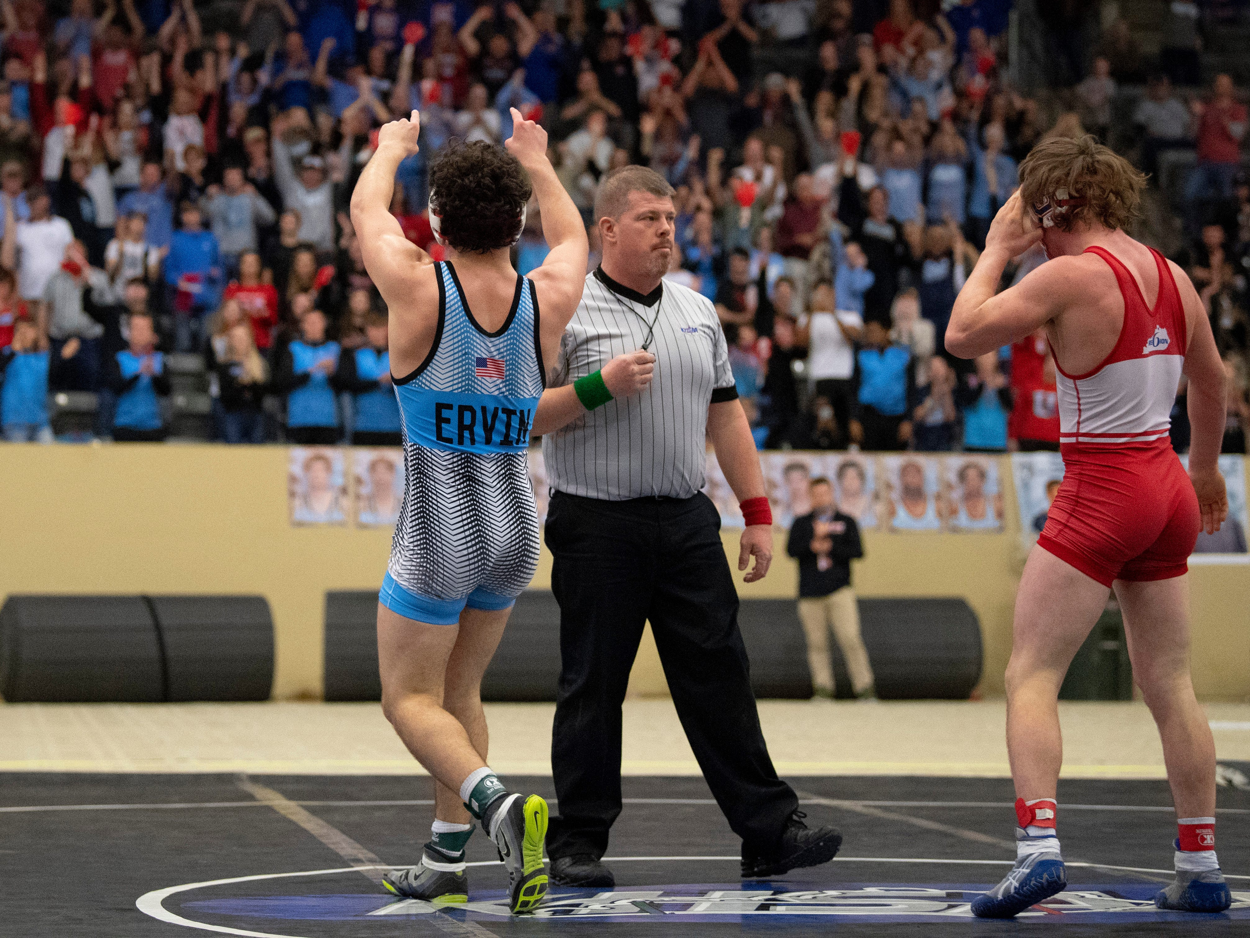 Union County's Micah Ervin celebrates his win over Conner's Clayton Boyd after their 170-pound championship match at the KHSAA State Wrestling Championships at the Alltech Arena in Lexington, Ky., Saturday afternoon. Ervin won the match with a 5-3 decision to take home the state championship.