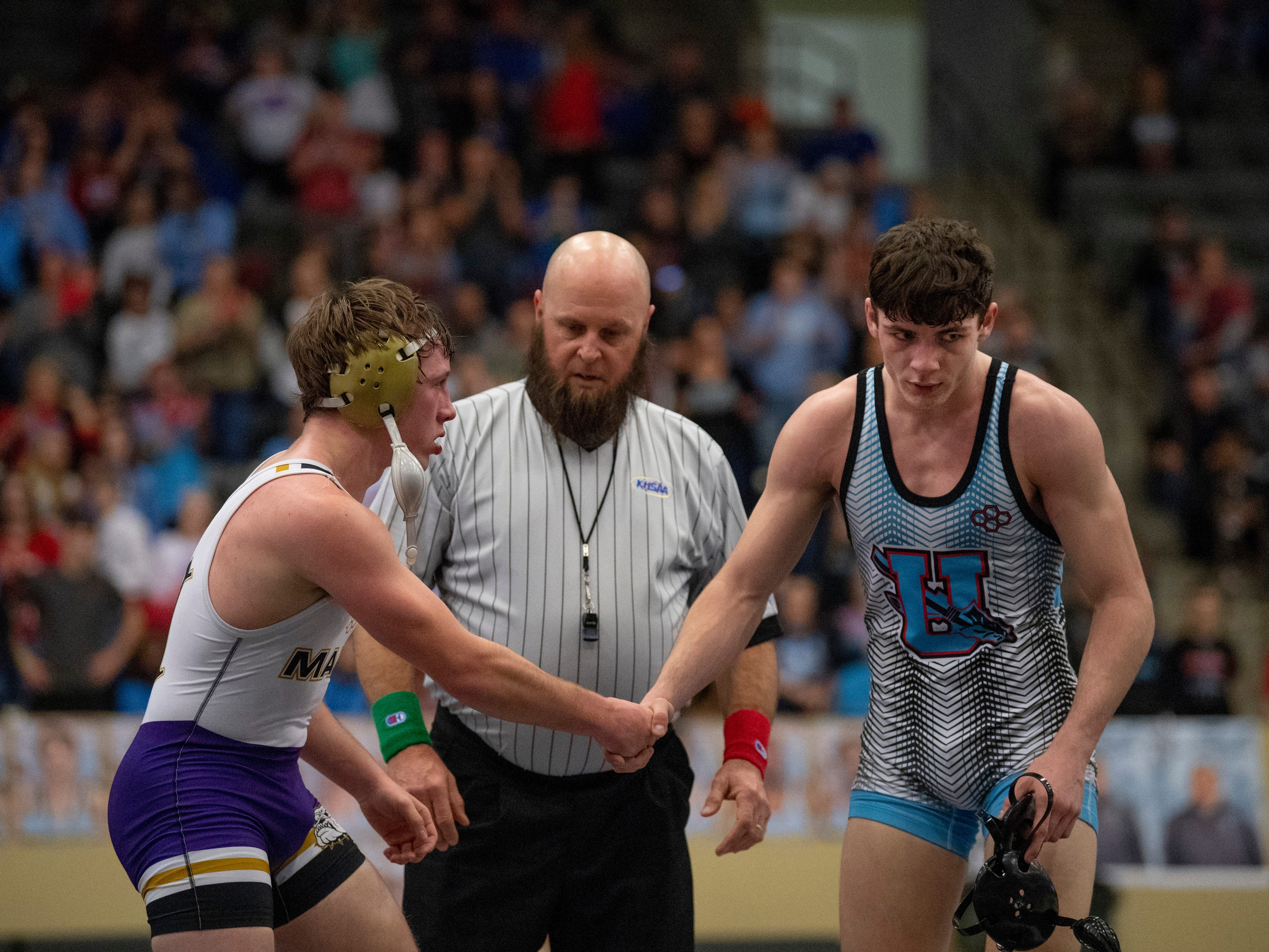 Male's Zane Brown and Union County's Stephen Little shake hands after their 160-pound championship match at the KHSAA State Wrestling Championships at the Alltech Arena in Lexington, Ky., Saturday afternoon. Brown beat Little for his third state championship.
