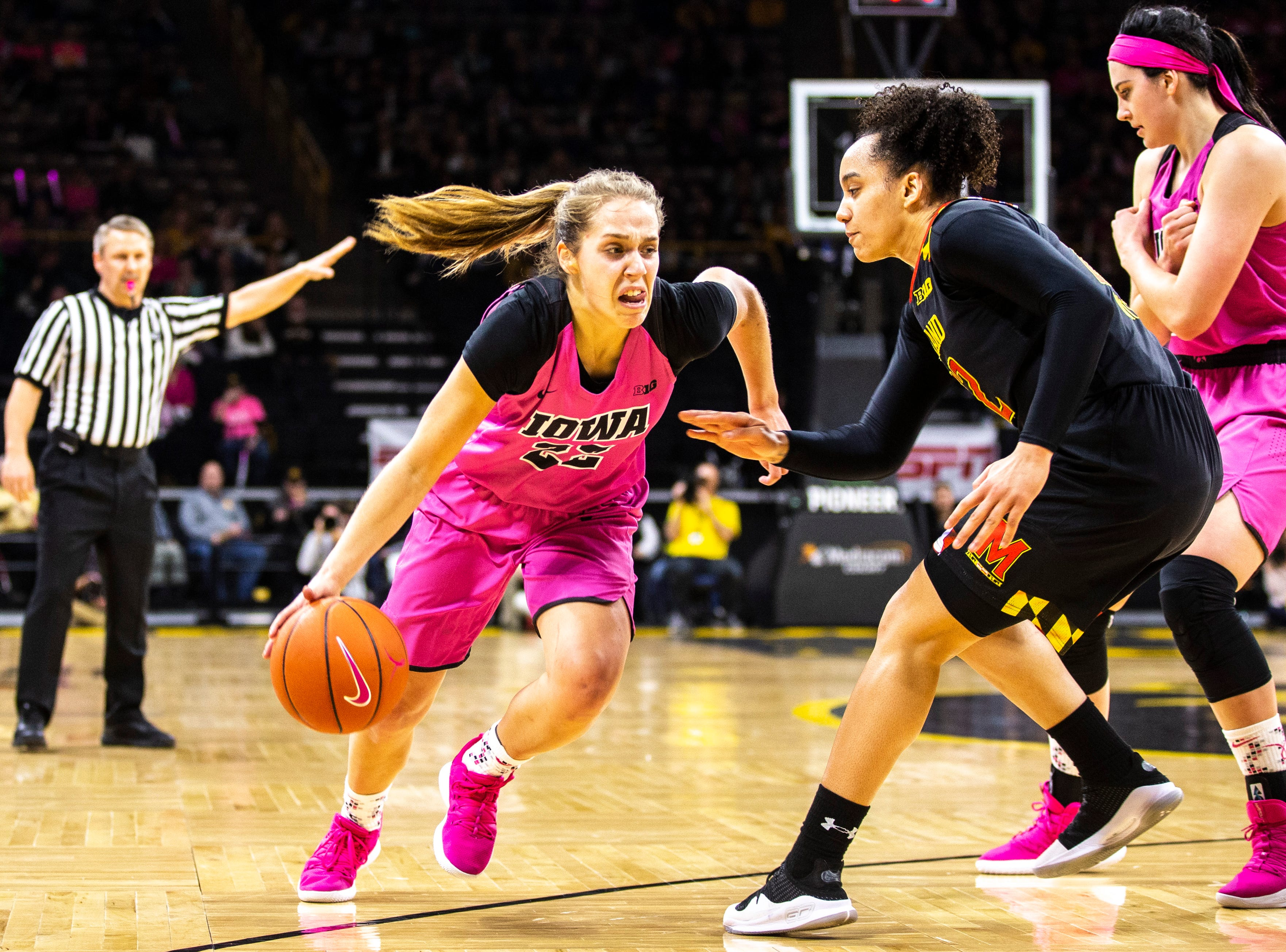Iowa guard Kathleen Doyle (22) drives to the basket while Maryland guard Blair Watson, right, defends during a NCAA Big Ten Conference women's basketball game on Sunday, Feb. 17, 2019 at Carver-Hawkeye Arena in Iowa City, Iowa.