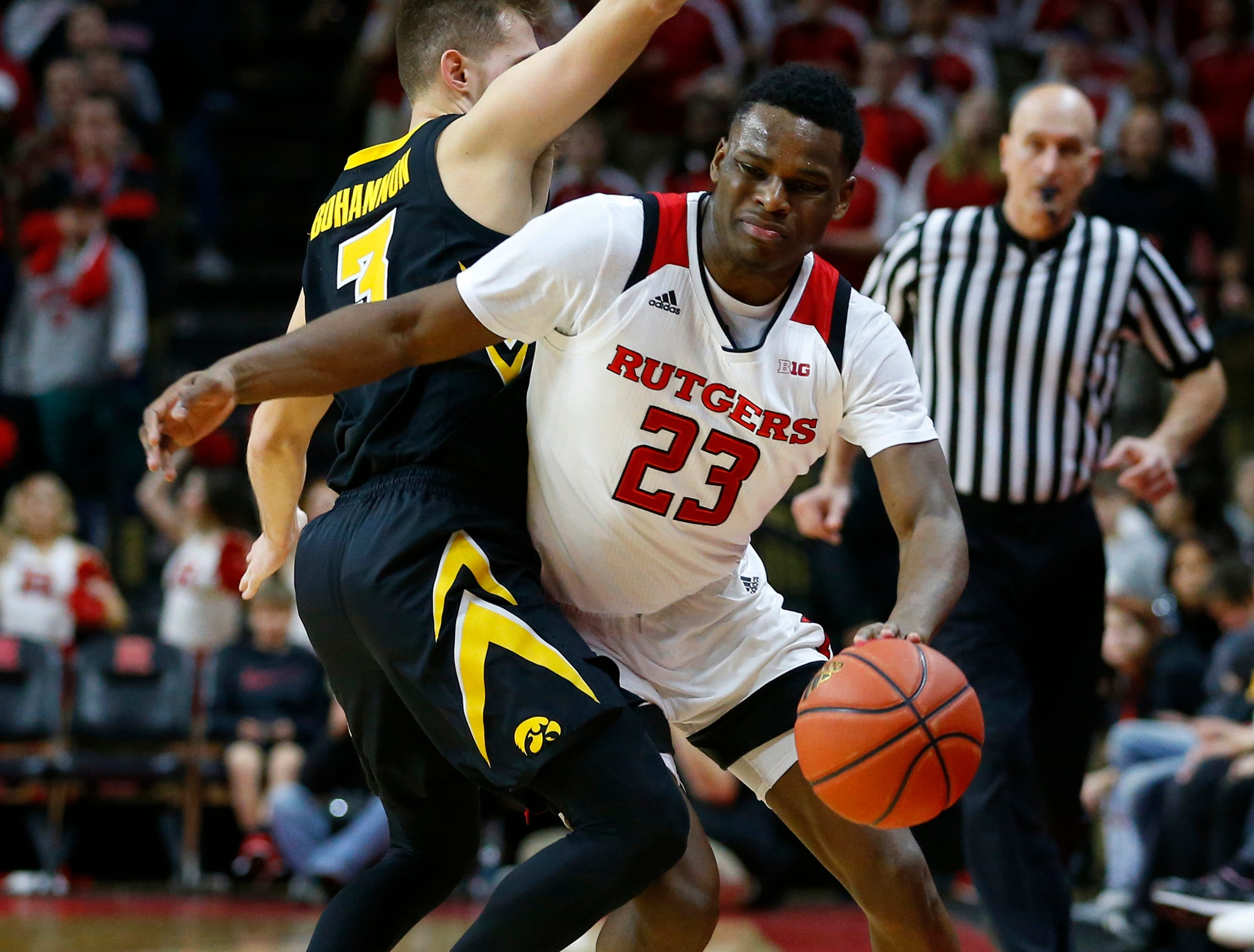Iowa Hawkeyes guard Jordan Bohannon (3) defends against Rutgers Scarlet Knights guard Montez Mathis (23) during the second half at Rutgers Athletic Center (RAC). Mandatory Credit: Noah K. Murray-USA TODAY Sports