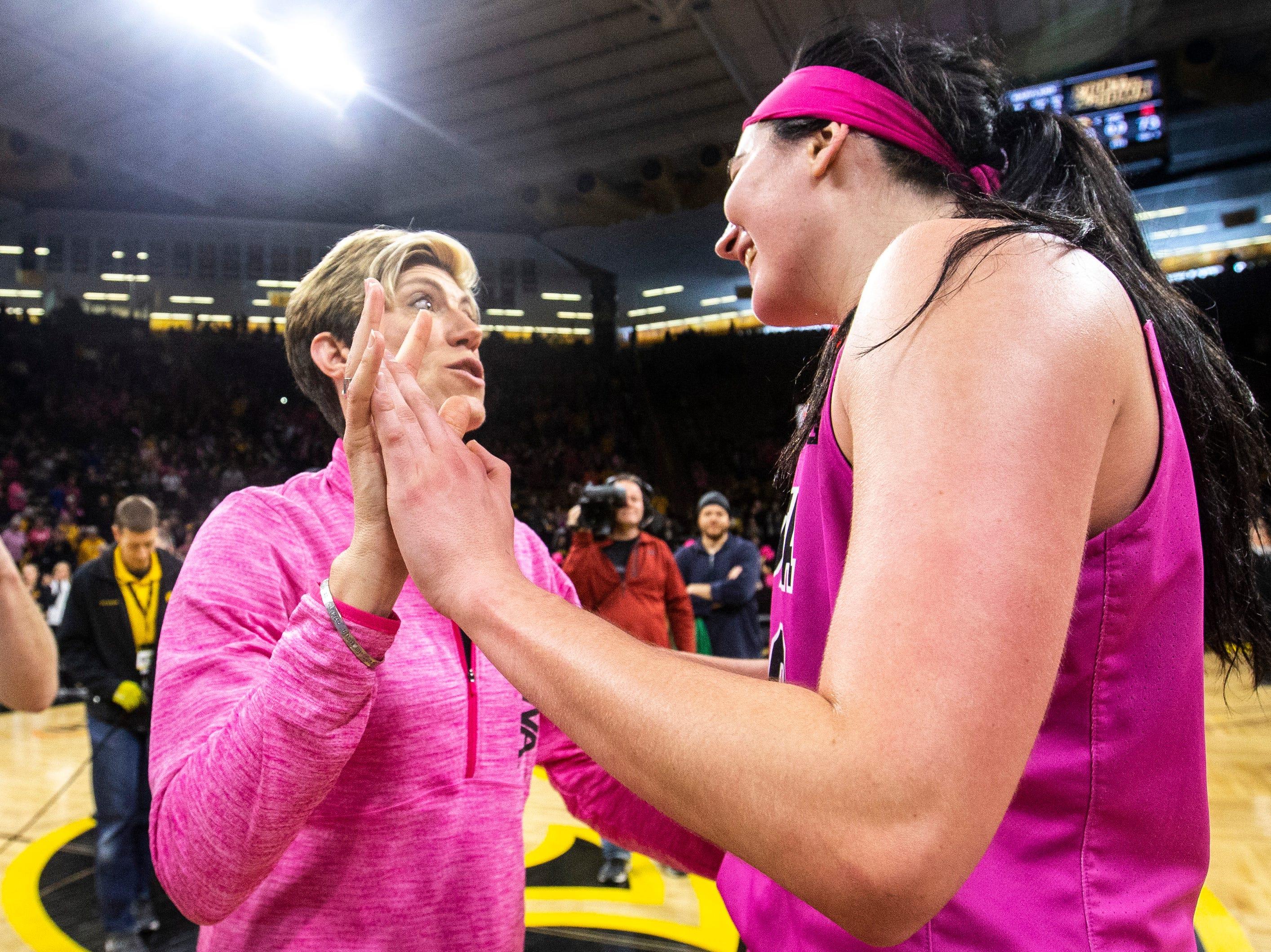 Iowa associate head coach Jan Jensen talks with Iowa center Megan Gustafson (10) after a NCAA Big Ten Conference women's basketball game on Sunday, Feb. 17, 2019 at Carver-Hawkeye Arena in Iowa City, Iowa.