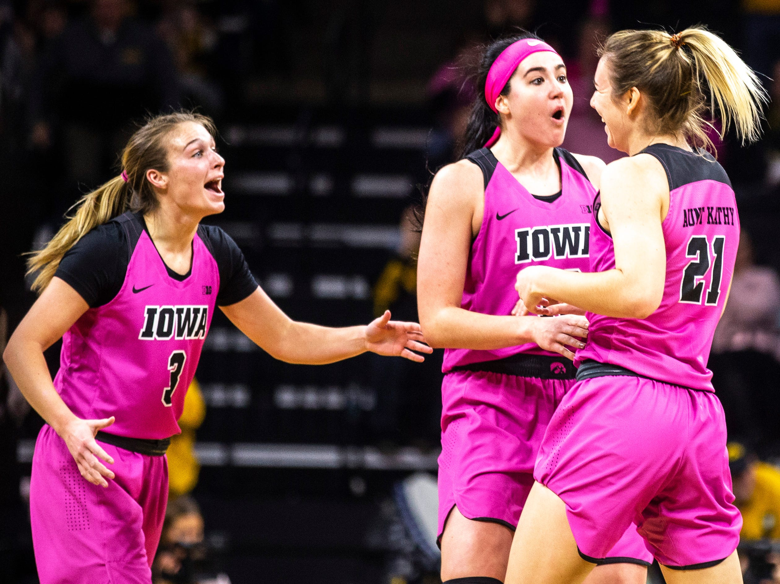 Iowa guard Makenzie Meyer (3) center Megan Gustafson (10) and forward Hannah Stewart (21) celebrate heading into a timeout during a NCAA Big Ten Conference women's basketball game on Sunday, Feb. 17, 2019 at Carver-Hawkeye Arena in Iowa City, Iowa.