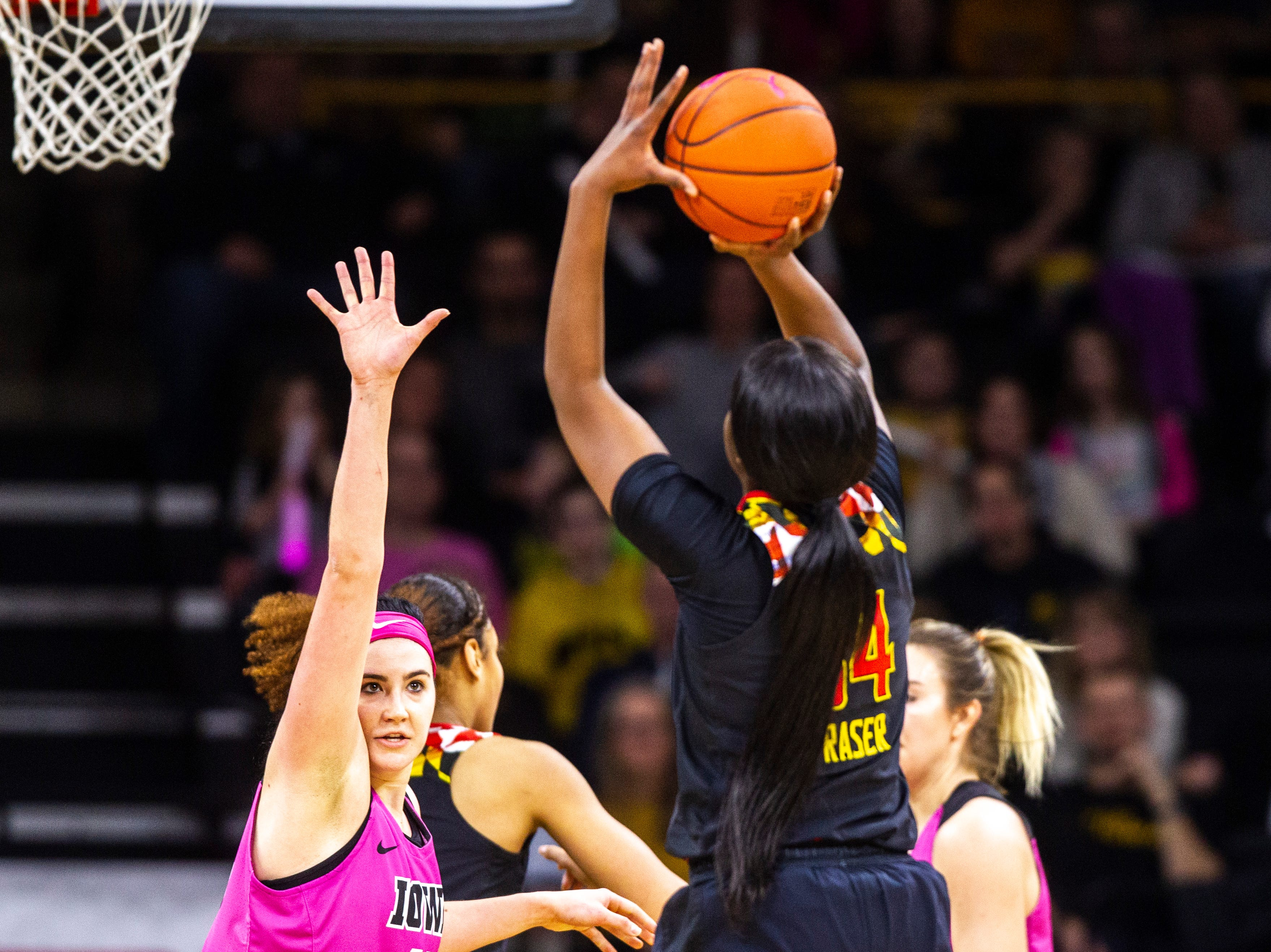 Maryland forward Brianna Fraser (34) attempts a basket while Iowa center Megan Gustafson defends during a NCAA Big Ten Conference women's basketball game on Sunday, Feb. 17, 2019 at Carver-Hawkeye Arena in Iowa City, Iowa.