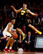Iowa forward Joe Wieskamp leaps to deny Rutgers forward Ron Harper Jr. a 3-point attempt during the first half Saturday at the RAC.