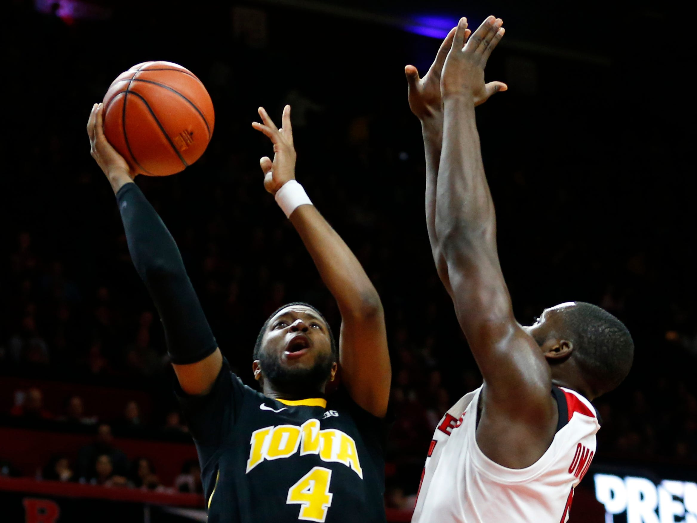 Iowa Hawkeyes guard Isaiah Moss (4) goes to the basket against Rutgers Scarlet Knights forward Eugene Omoruyi (5) during the first half at Rutgers Athletic Center (RAC). Mandatory Credit: Noah K. Murray-USA TODAY Sports