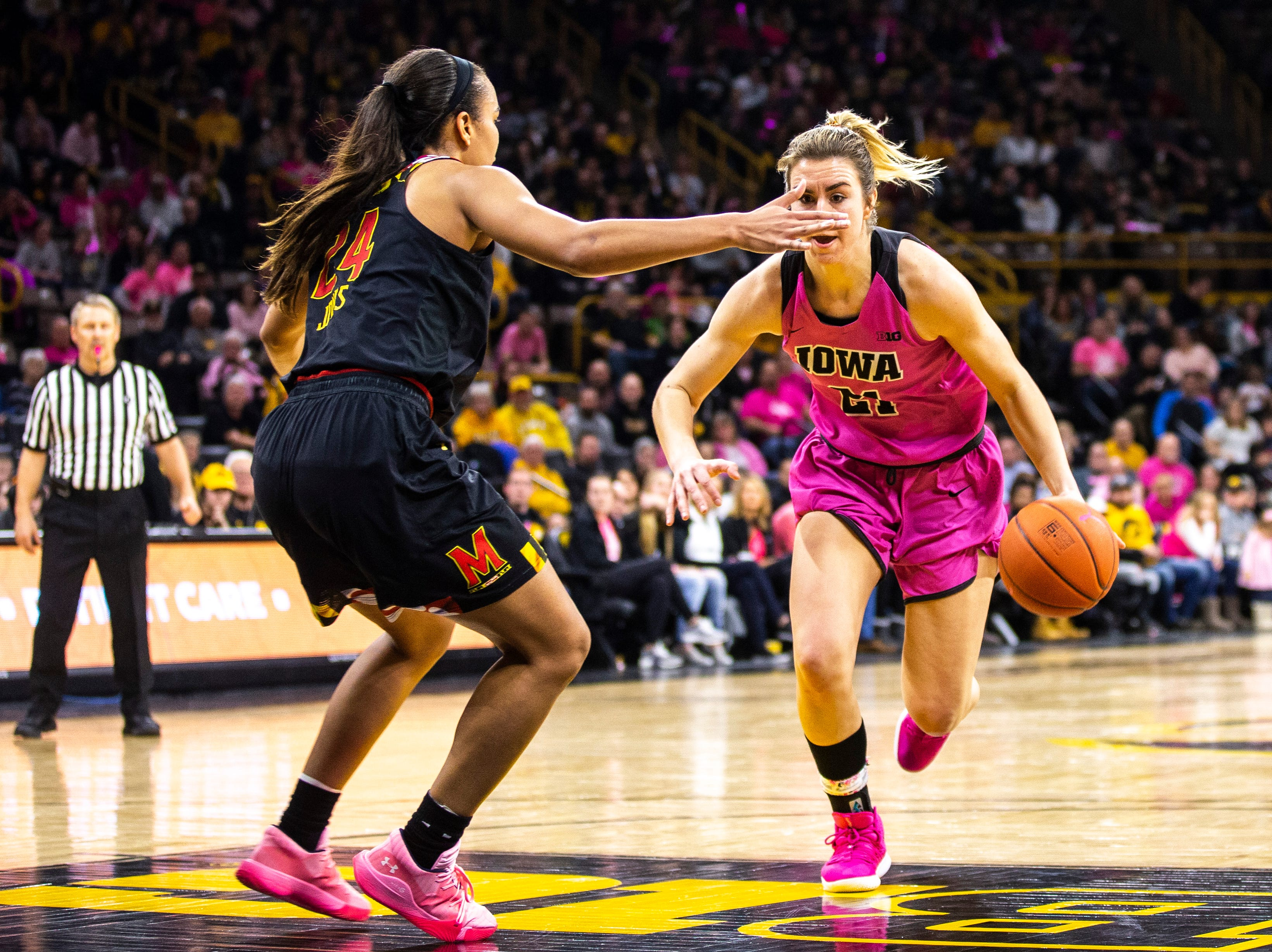 Iowa forward Hannah Stewart (21) drives to the basket while Maryland forward Stephanie Jones (24) defends during a NCAA Big Ten Conference women's basketball game on Sunday, Feb. 17, 2019 at Carver-Hawkeye Arena in Iowa City, Iowa.