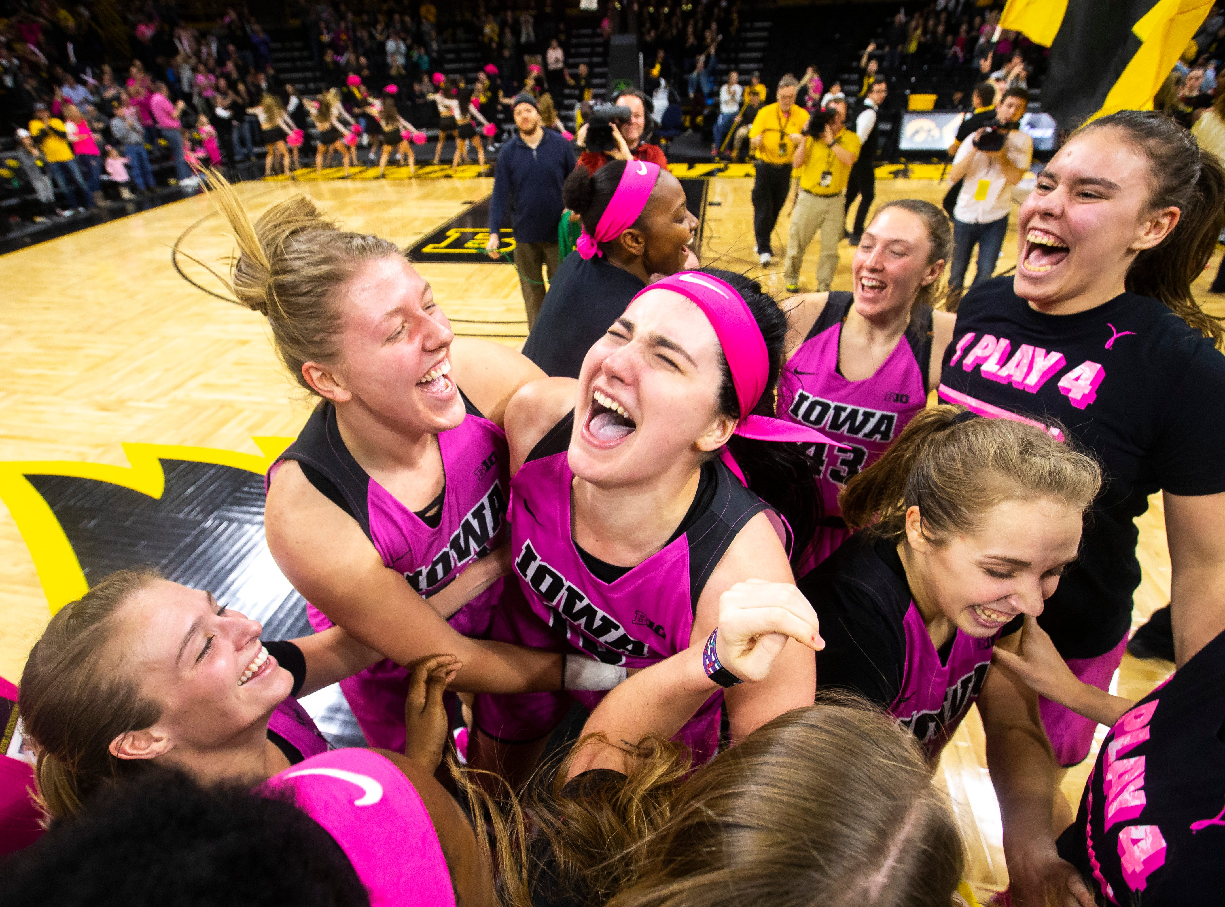 Iowa center Megan Gustafson (10) is embraced by teammates after a NCAA Big Ten Conference women's basketball game against Maryland on Sunday, Feb. 17, 2019 at Carver-Hawkeye Arena in Iowa City, Iowa. The Hawkeyes defeated the Terrapins, 86-73.