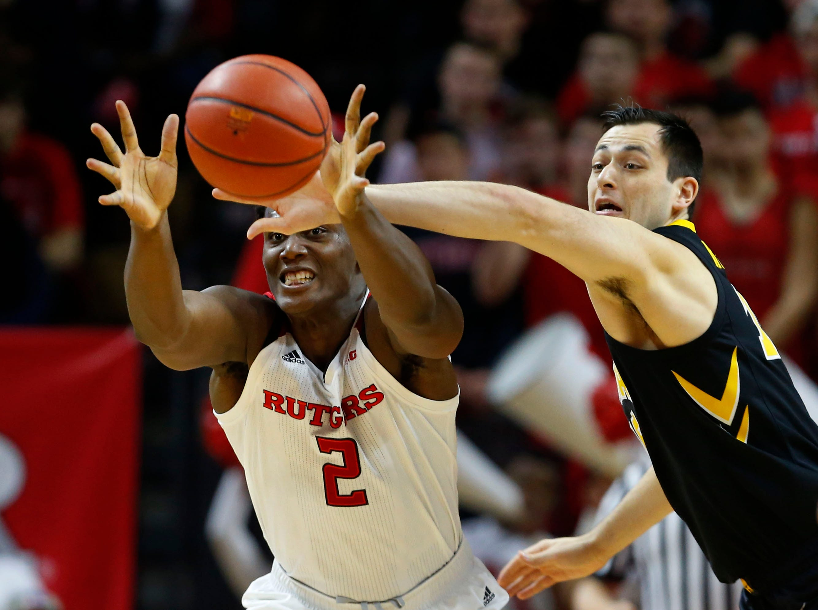 Iowa Hawkeyes forward Ryan Kriener (15) defends against Rutgers Scarlet Knights center Shaquille Doorson (2) during the first half at Rutgers Athletic Center (RAC). Mandatory Credit: Noah K. Murray-USA TODAY Sports