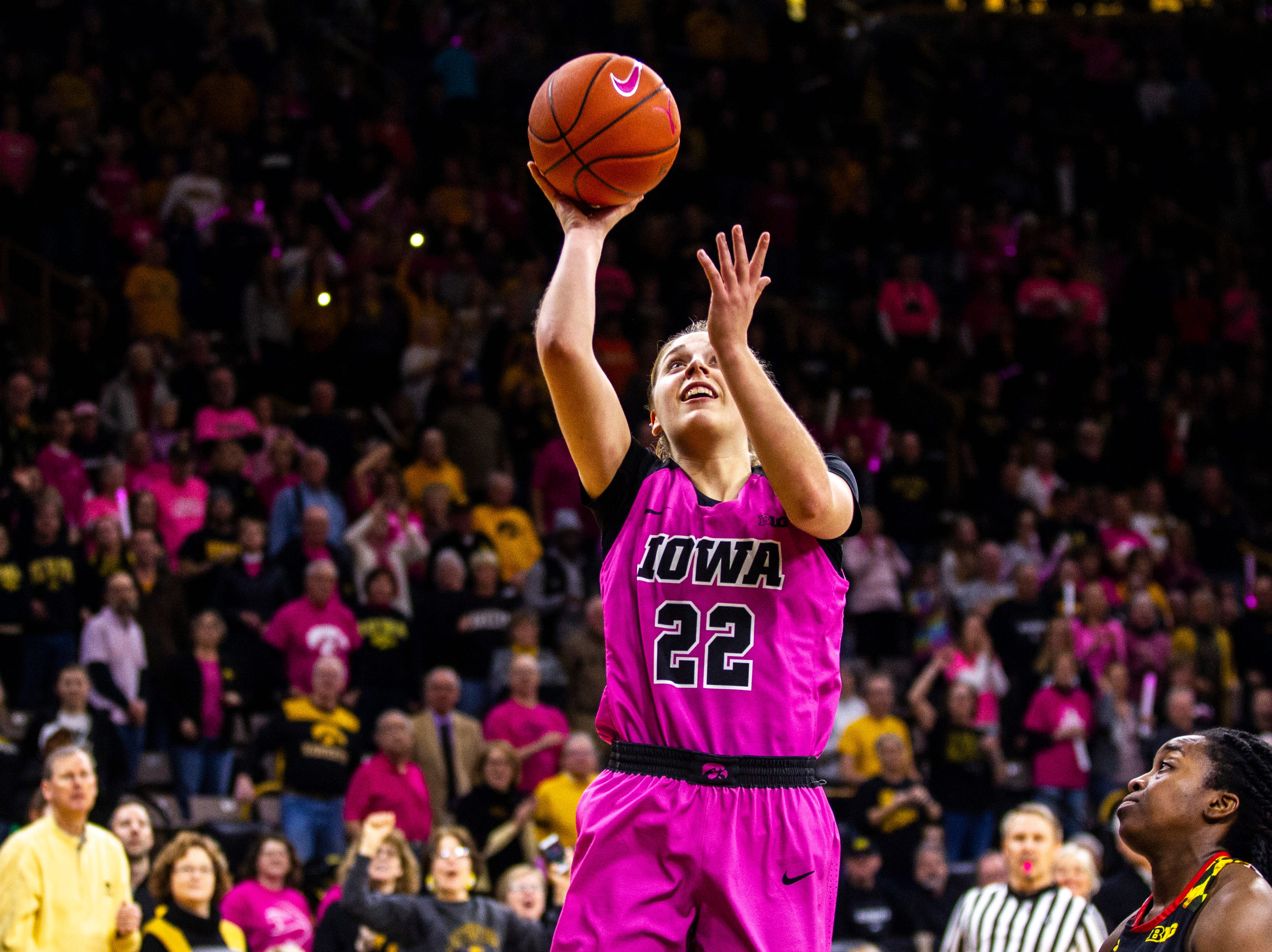 Iowa guard Kathleen Doyle (22) makes a layup during a NCAA Big Ten Conference women's basketball game on Sunday, Feb. 17, 2019 at Carver-Hawkeye Arena in Iowa City, Iowa.