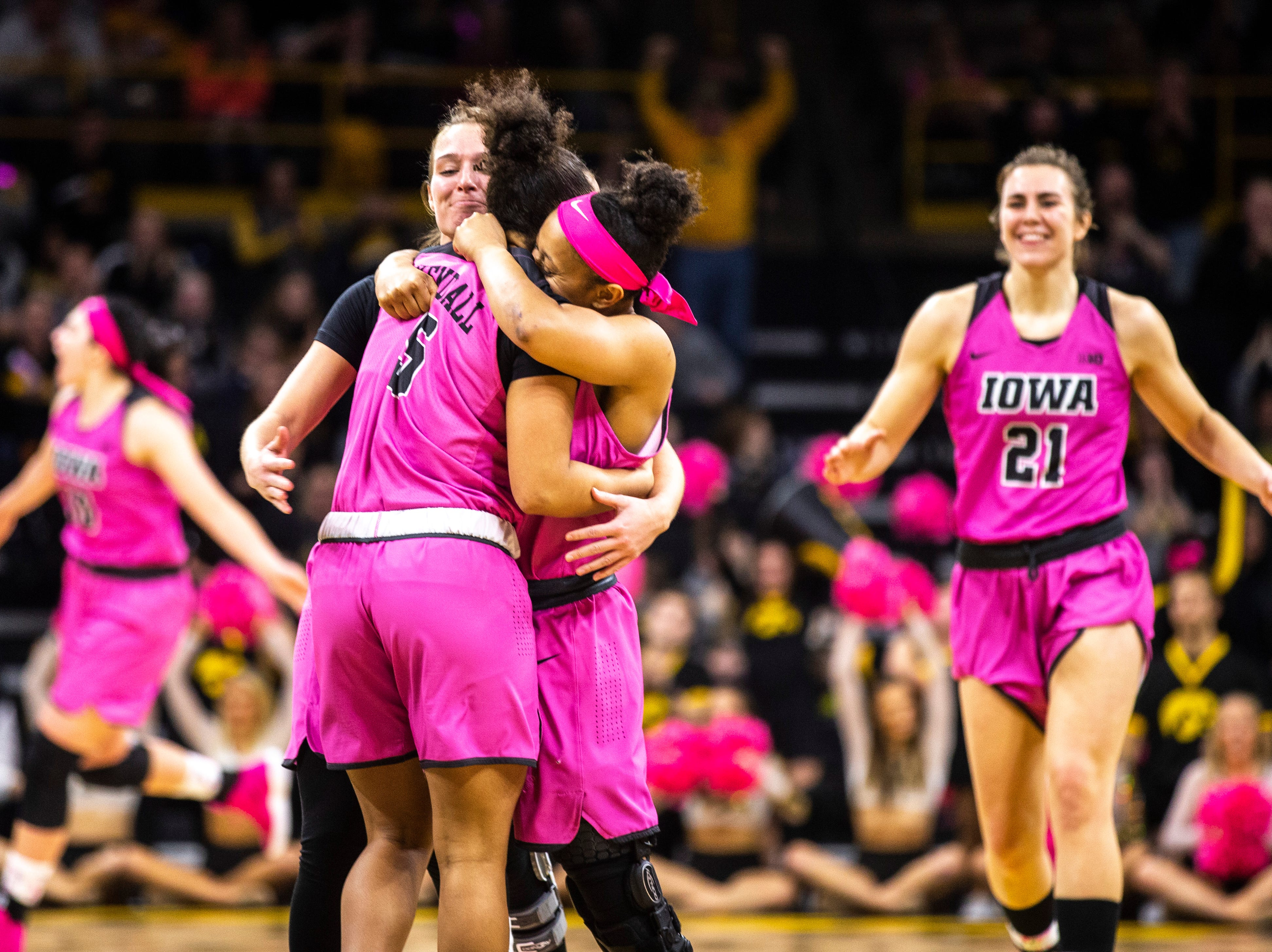 Iowa guard Alexis Sevillian (5) gets embraced by Iowa guard Tania Davis after making a 3-point basket during a NCAA Big Ten Conference women's basketball game on Sunday, Feb. 17, 2019 at Carver-Hawkeye Arena in Iowa City, Iowa.