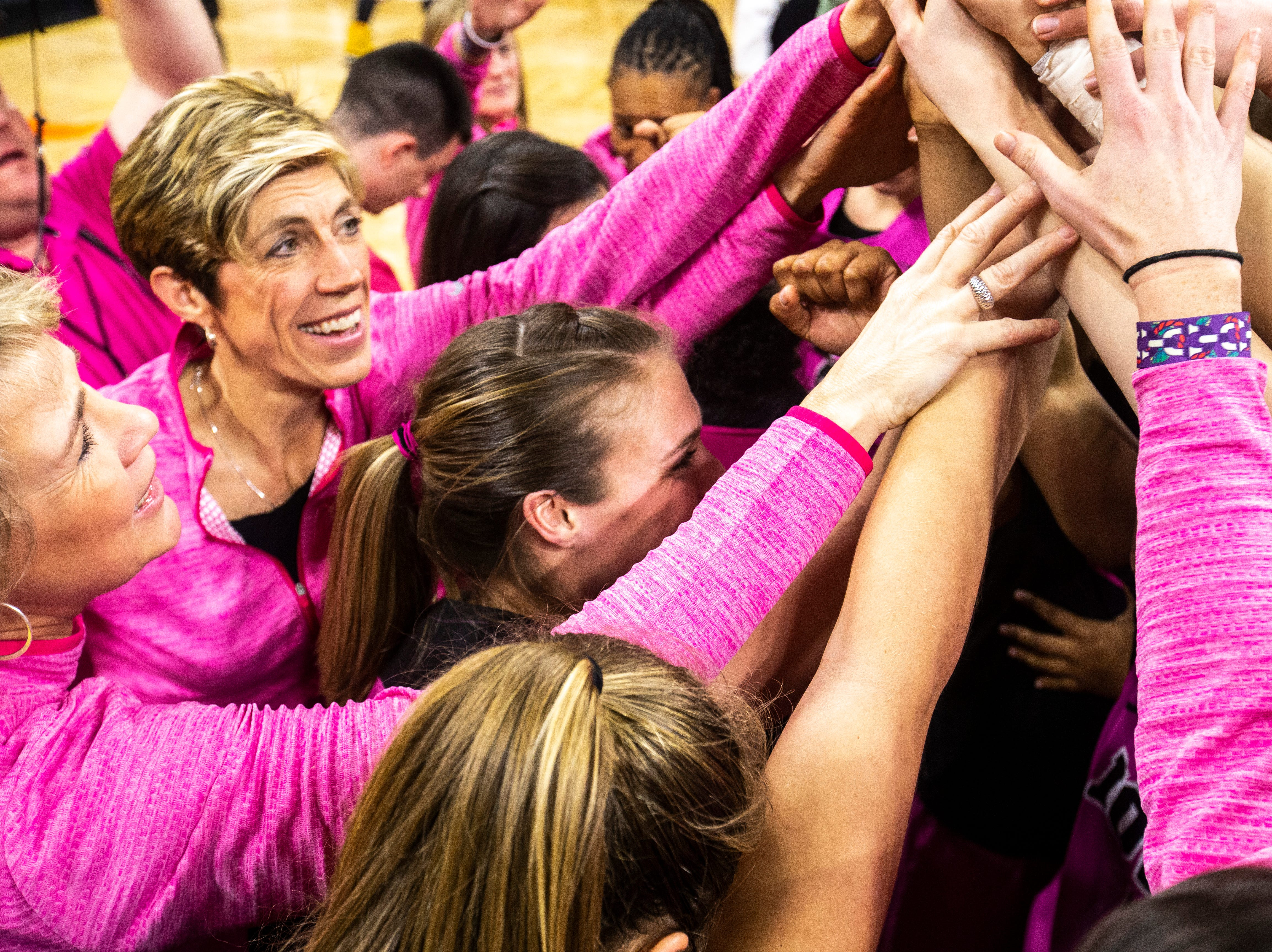 Iowa head coach Lisa Bluder and associate Jan Jensen huddle with players after a NCAA Big Ten Conference women's basketball game against Maryland on Sunday, Feb. 17, 2019 at Carver-Hawkeye Arena in Iowa City, Iowa.