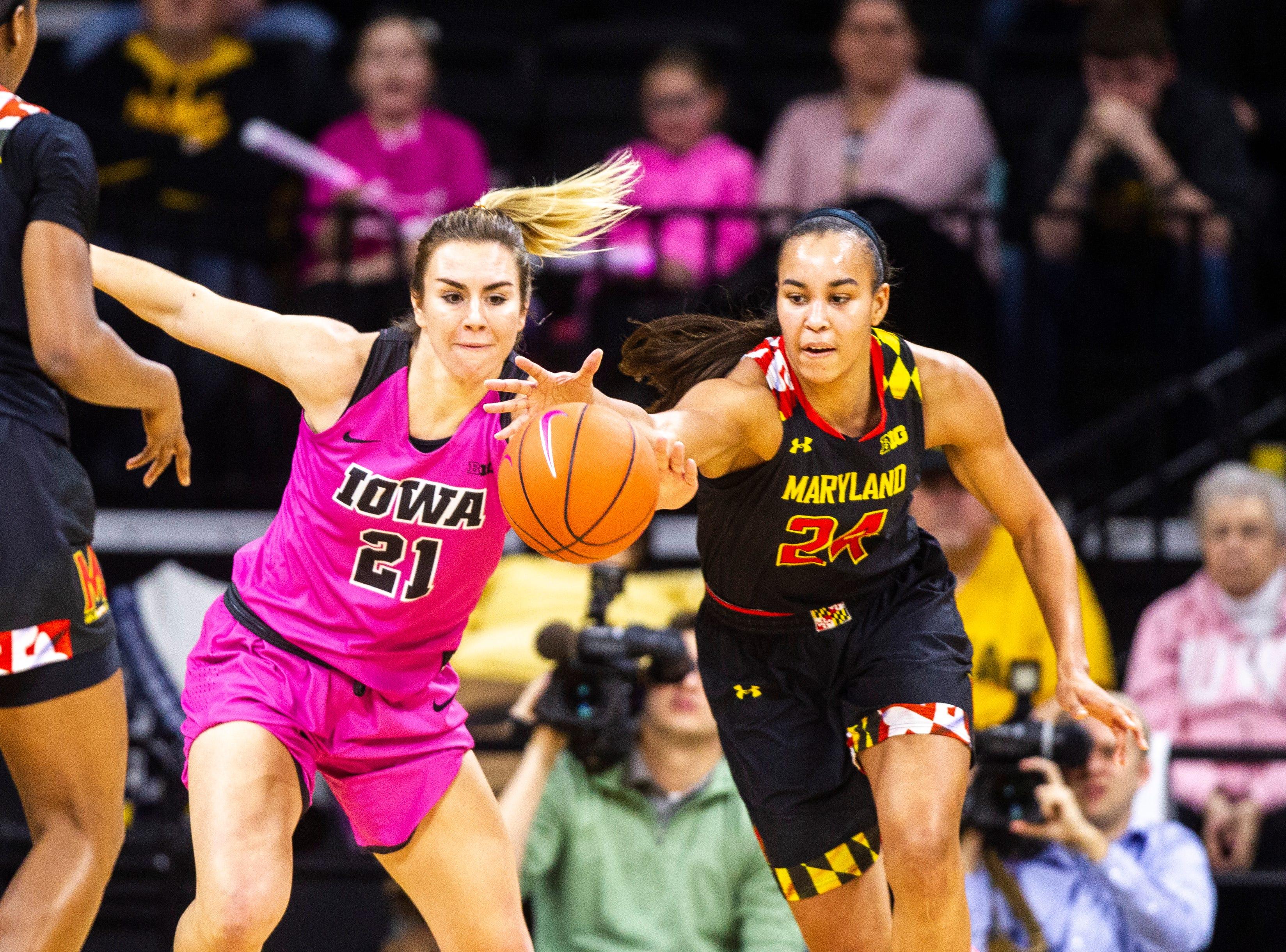 Iowa forward Hannah Stewart (21) battles Maryland forward Stephanie Jones (24) for a loose ball during a NCAA Big Ten Conference women's basketball game on Sunday, Feb. 17, 2019 at Carver-Hawkeye Arena in Iowa City, Iowa.