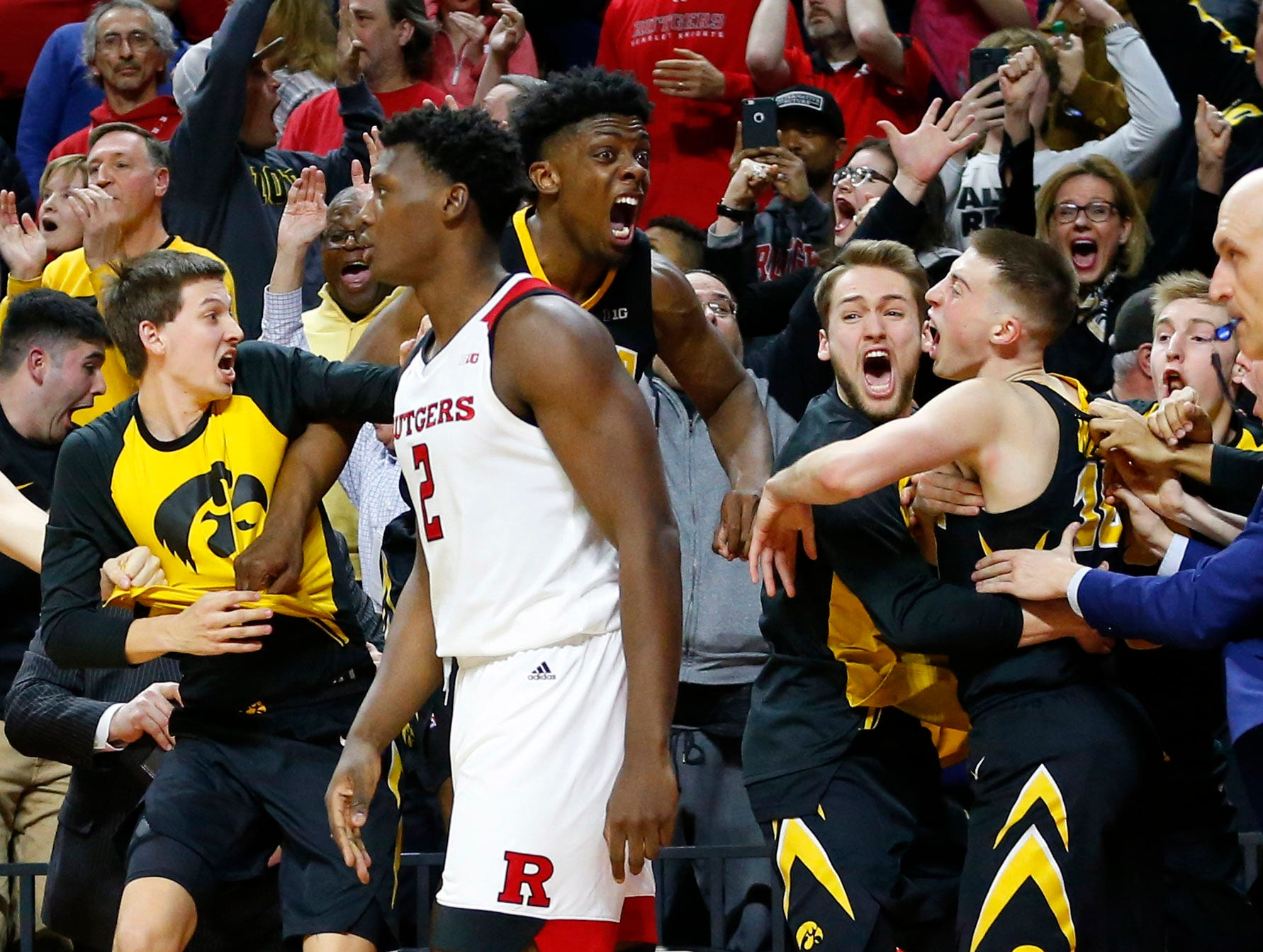 The Iowa Hawkeyes celebrate with Joe Wieskamp after defeating the Rutgers Scarlet Knights 71-69  at Rutgers Athletic Center (RAC). Mandatory Credit: Noah K. Murray-USA TODAY Sports