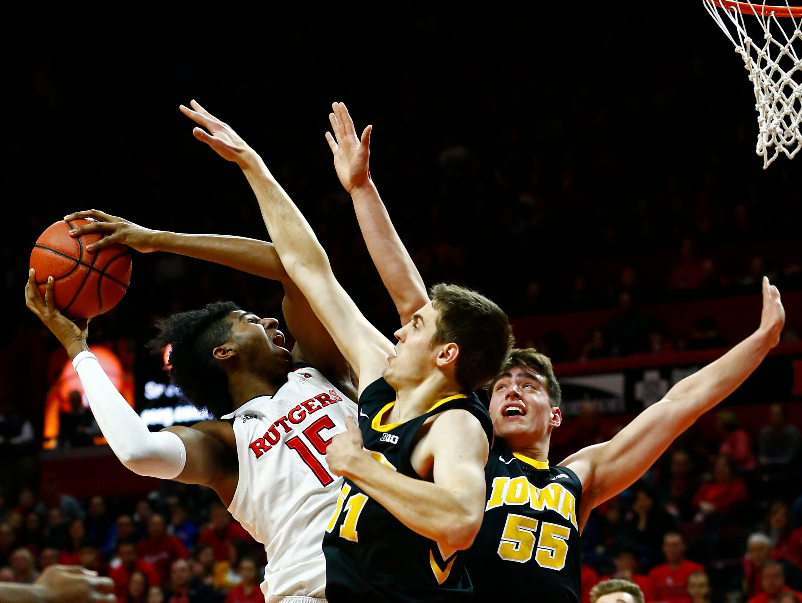 Iowa Hawkeyes forward Nicholas Baer (51) and forward Luka Garza (55) defend against Rutgers Scarlet Knights center Myles Johnson (15) during the first half at Rutgers Athletic Center (RAC). Mandatory Credit: Noah K. Murray-USA TODAY Sports