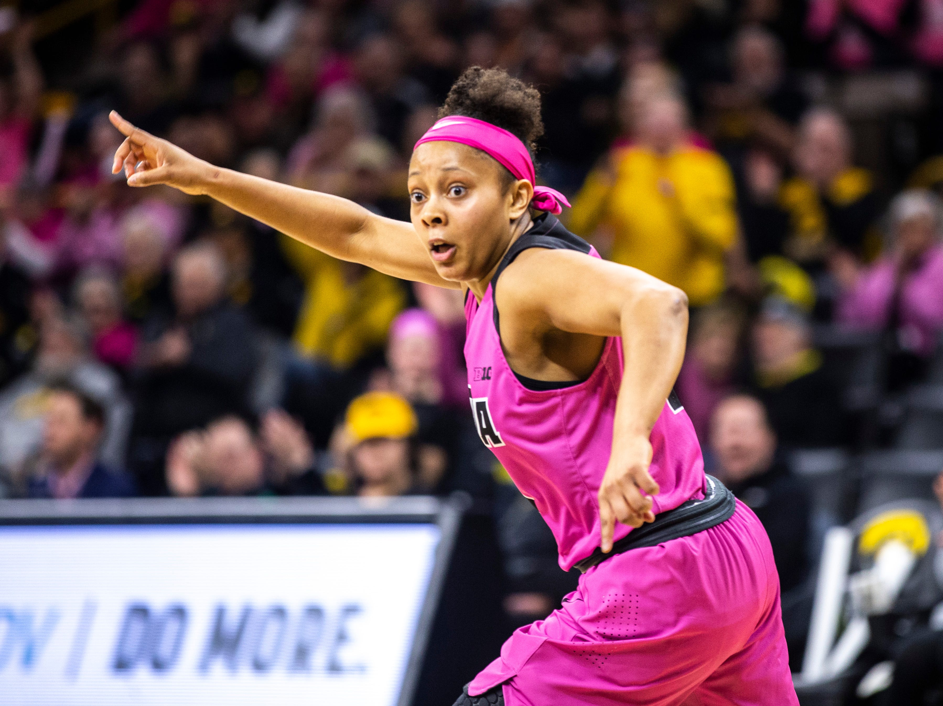 Iowa guard Tania Davis (11) gestures after making a basket during a NCAA Big Ten Conference women's basketball game on Sunday, Feb. 17, 2019 at Carver-Hawkeye Arena in Iowa City, Iowa.