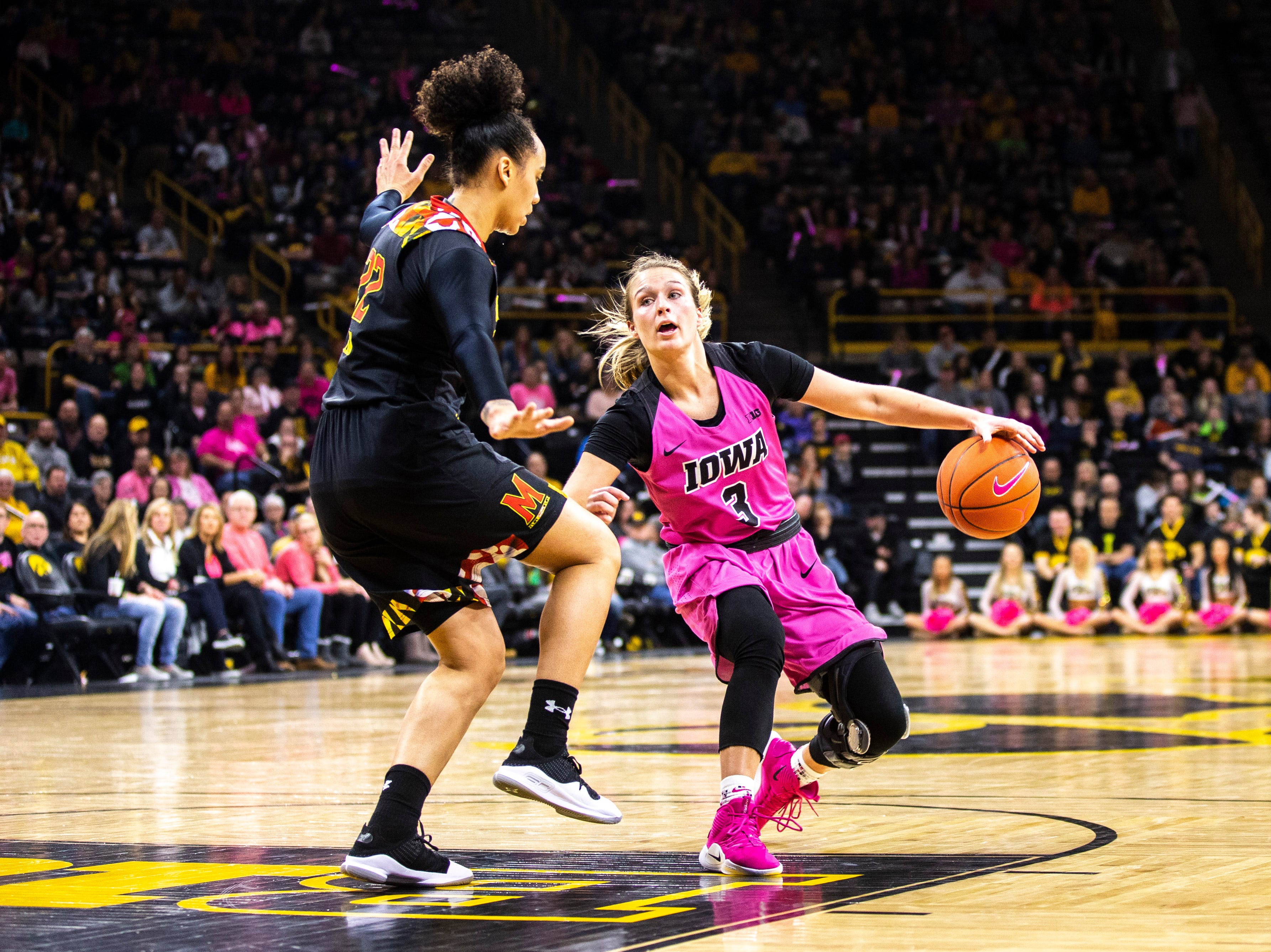 Iowa guard Makenzie Meyer (3) dribbles while Maryland guard Blair Watson (22) defends during a NCAA Big Ten Conference women's basketball game on Sunday, Feb. 17, 2019 at Carver-Hawkeye Arena in Iowa City, Iowa.