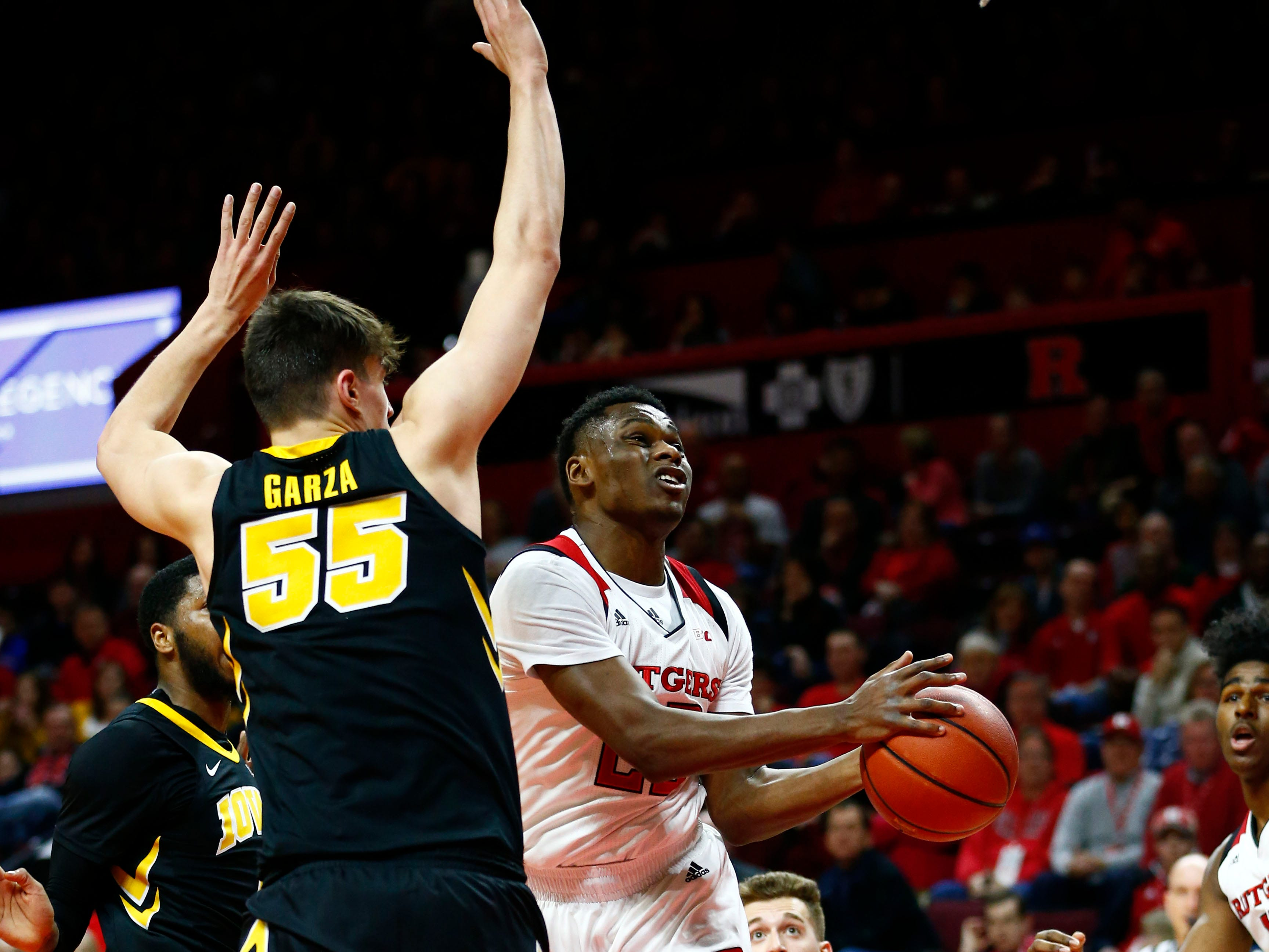 Rutgers Scarlet Knights guard Montez Mathis (23) goes to the basket against Iowa Hawkeyes forward Luka Garza (55) during the first half at Rutgers Athletic Center (RAC). Mandatory Credit: Noah K. Murray-USA TODAY Sports