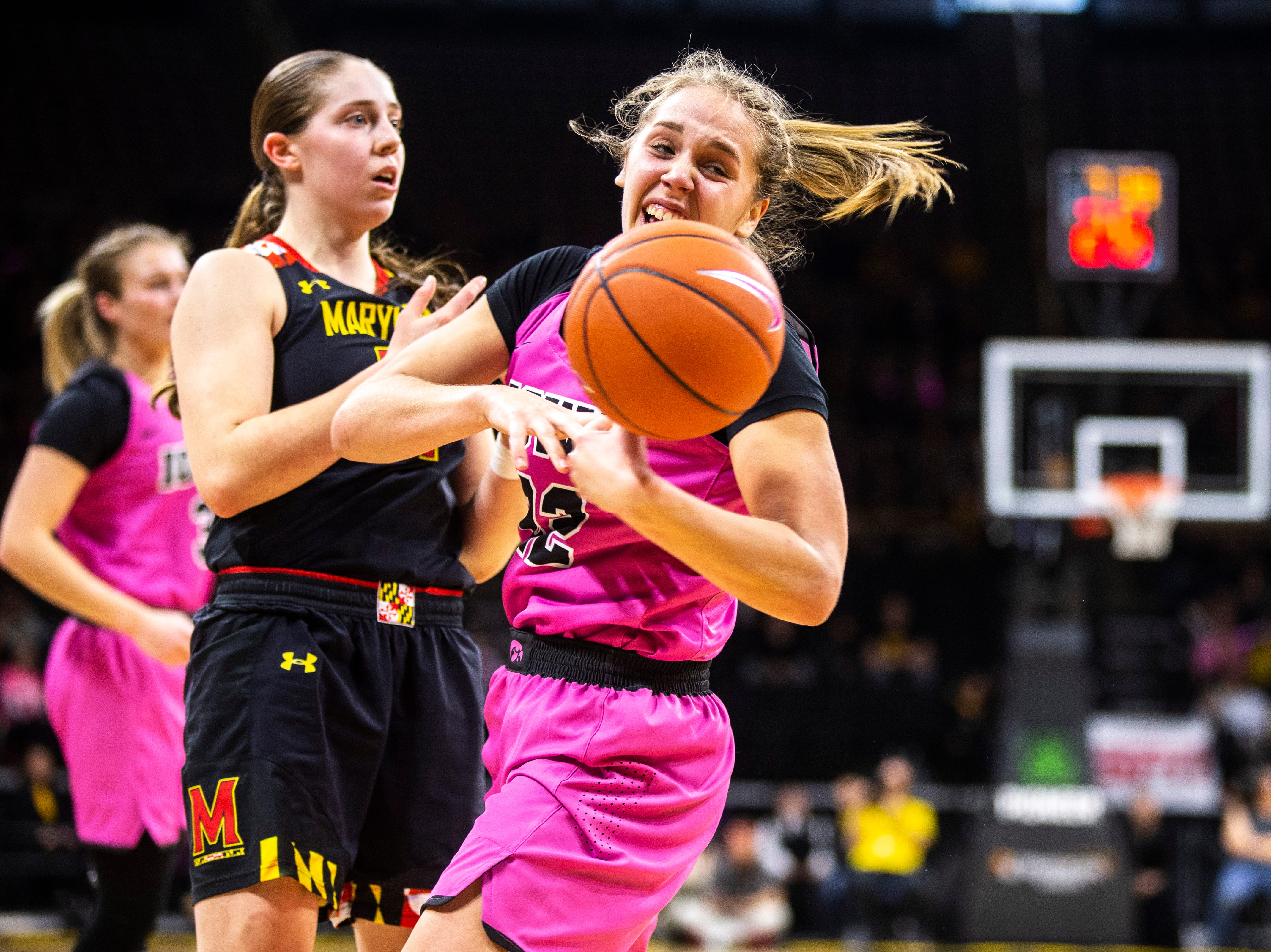 Iowa guard Kathleen Doyle (22) battles Maryland guard Taylor Mikesell, left, for a jump ball during a NCAA Big Ten Conference women's basketball game on Sunday, Feb. 17, 2019 at Carver-Hawkeye Arena in Iowa City, Iowa.