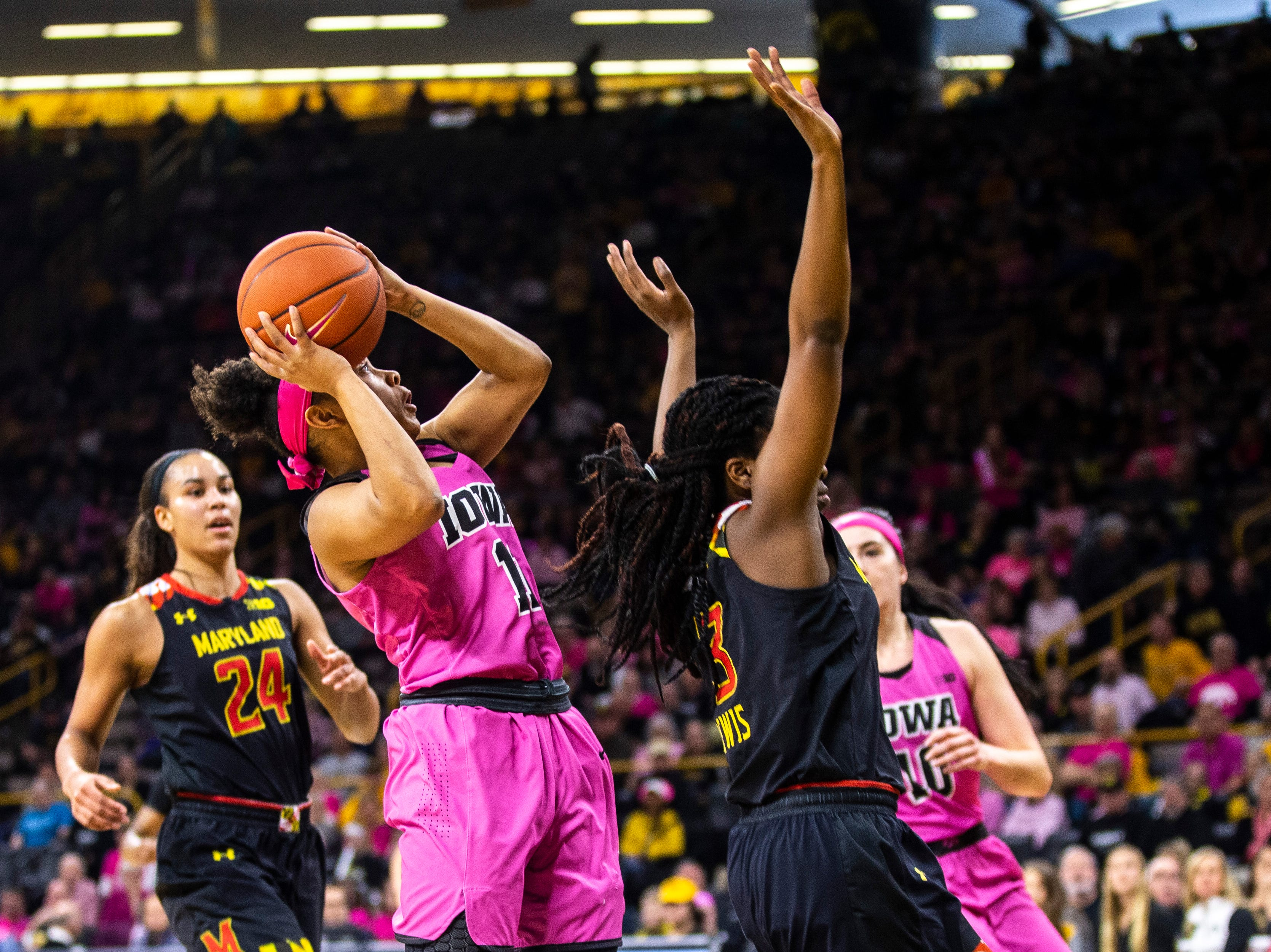 Iowa guard Tania Davis (11) attempts a basket while Maryland guard Channise Lewis (3) defends during a NCAA Big Ten Conference women's basketball game on Sunday, Feb. 17, 2019 at Carver-Hawkeye Arena in Iowa City, Iowa.