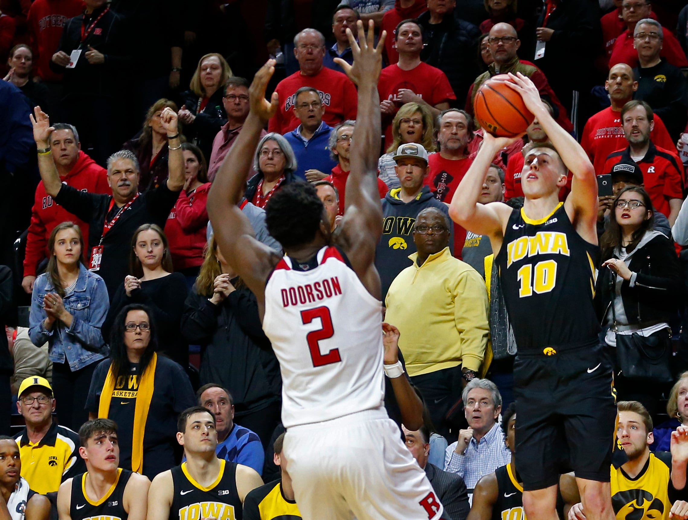Iowa Hawkeyes guard Joe Wieskamp (10) makes the game winning basket against Rutgers Scarlet Knights center Shaquille Doorson (2) during the second half at Rutgers Athletic Center (RAC). Mandatory Credit: Noah K. Murray-USA TODAY Sports