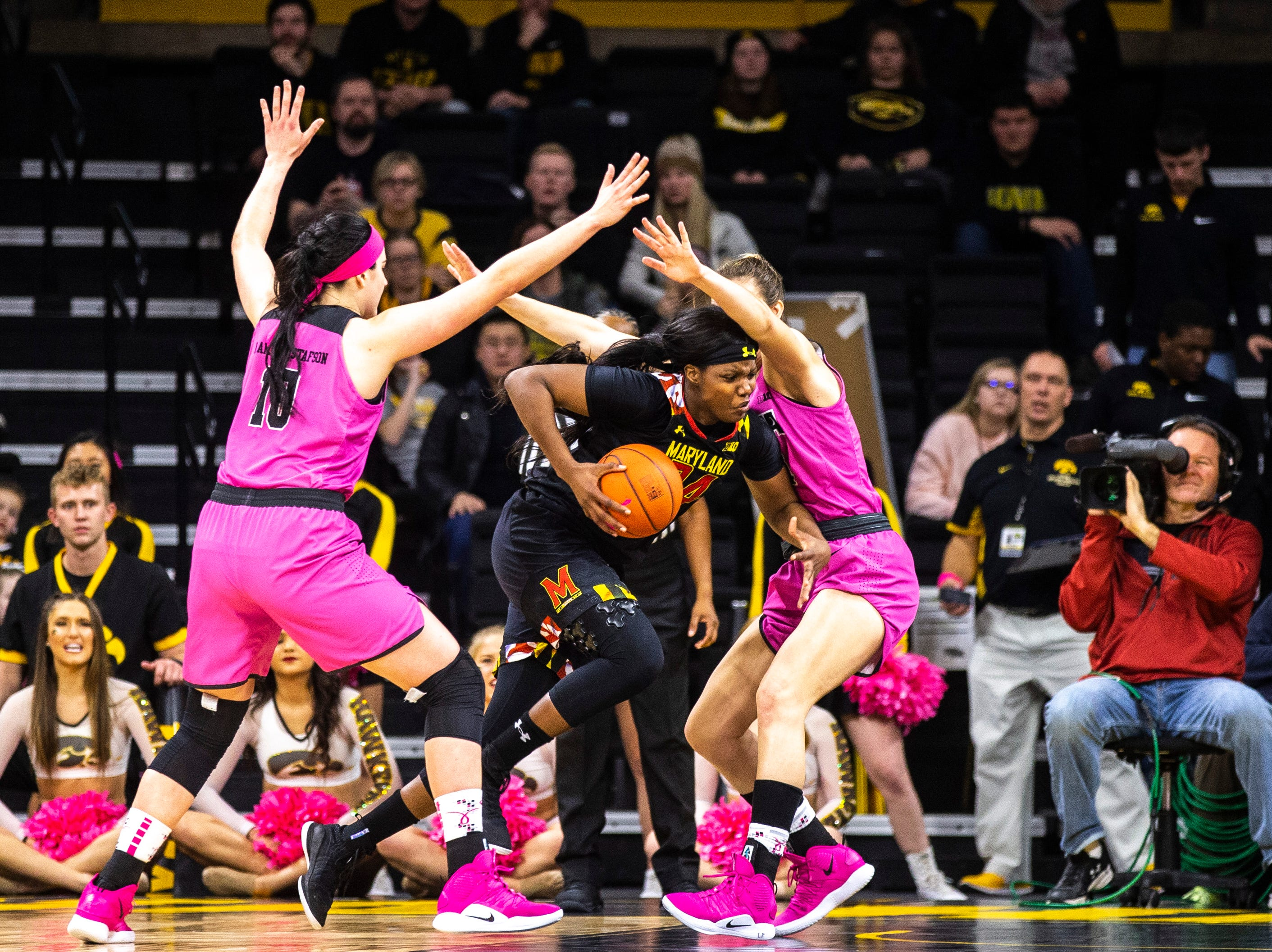 Maryland forward Brianna Fraser (34) drives to the basket while Iowa center Megan Gustafson (10) and Iowa forward Hannah Stewart, right, defend during a NCAA Big Ten Conference women's basketball game on Sunday, Feb. 17, 2019 at Carver-Hawkeye Arena in Iowa City, Iowa.