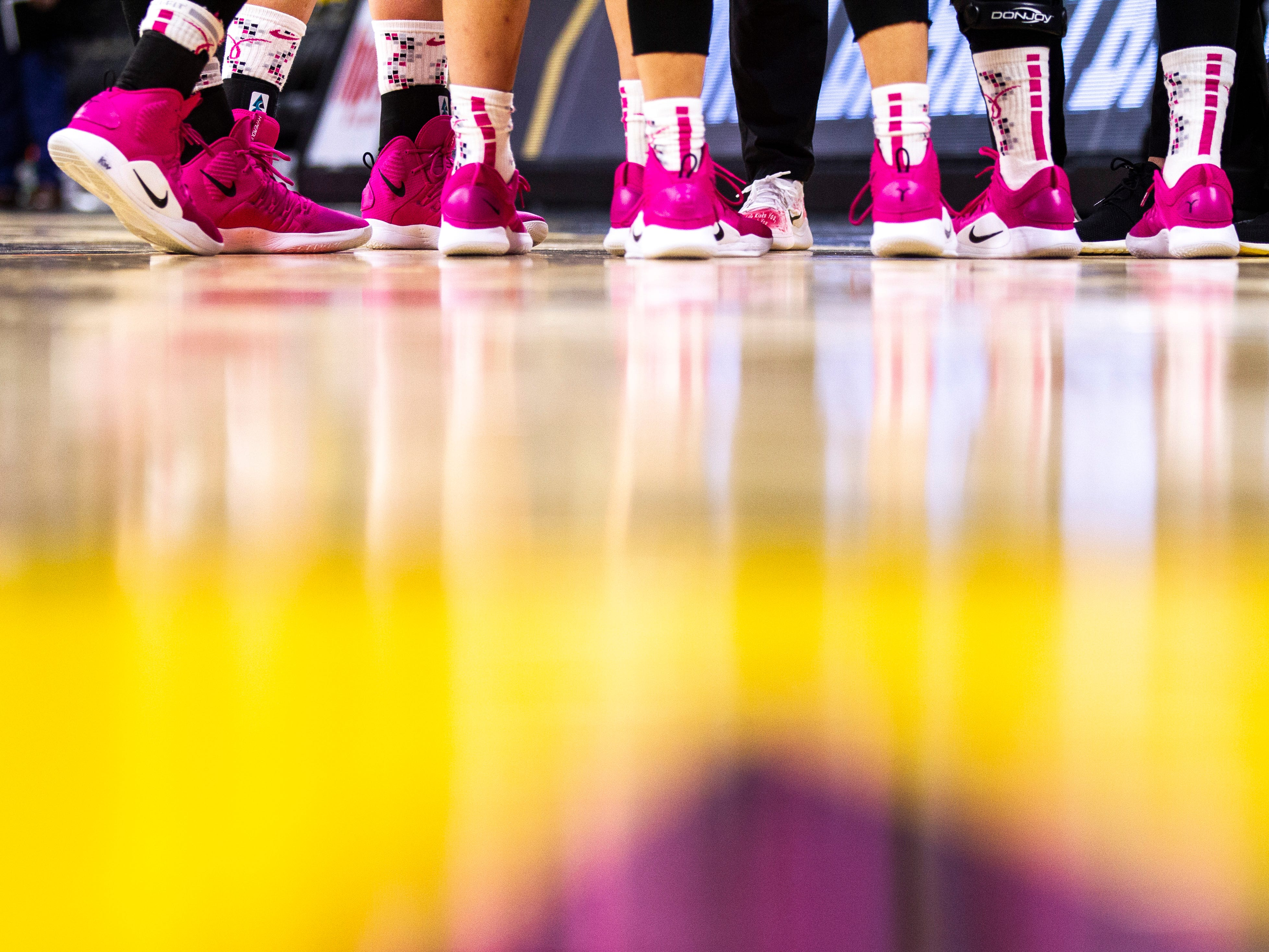 Iowa Hawkeyes wear pink Nike shoes during a NCAA Big Ten Conference women's basketball game on Sunday, Feb. 17, 2019 at Carver-Hawkeye Arena in Iowa City, Iowa.