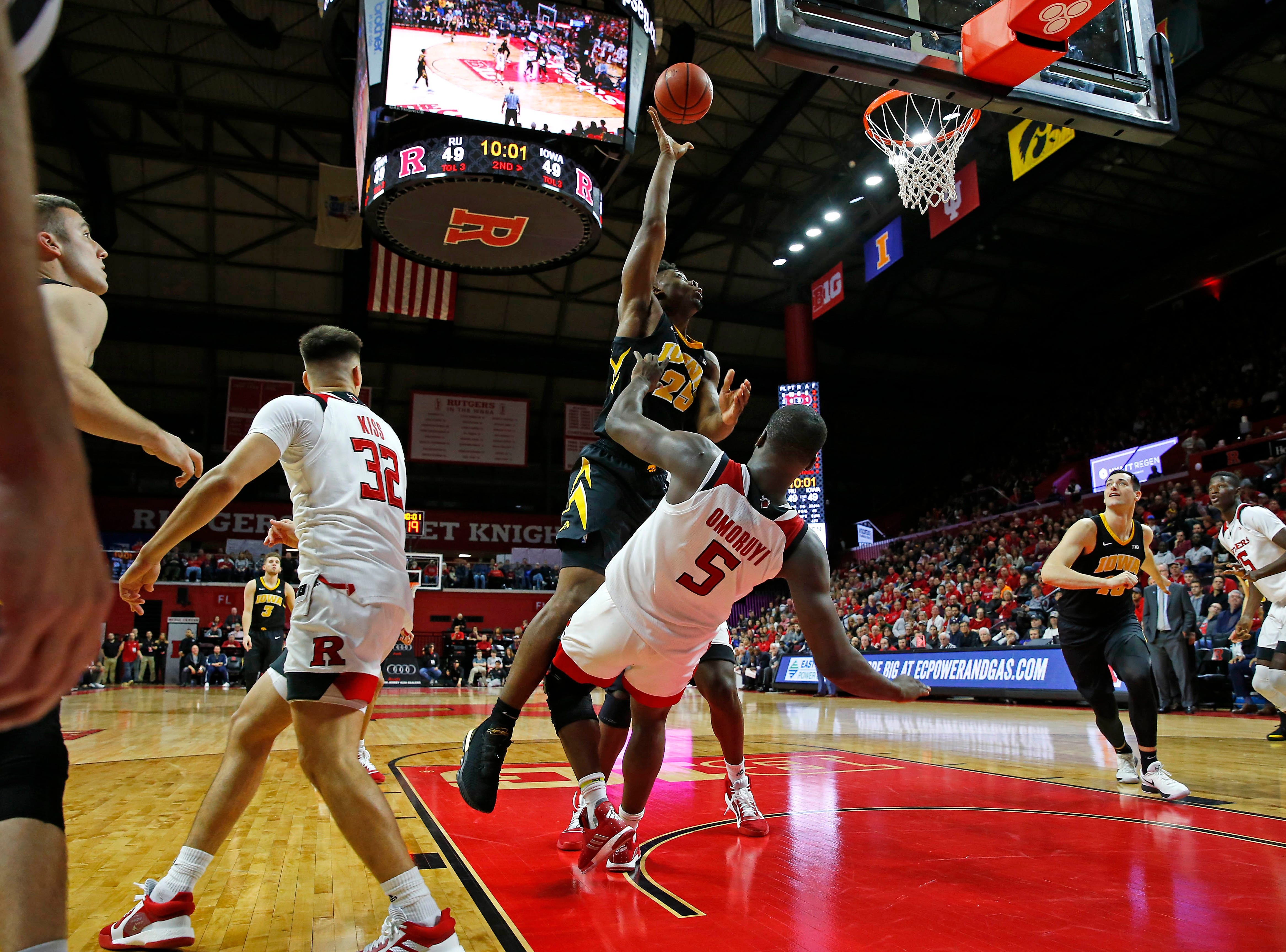 Iowa Hawkeyes forward Tyler Cook (25) gets to the basket against Rutgers Scarlet Knights forward Eugene Omoruyi (5) during the second half at Rutgers Athletic Center (RAC). Mandatory Credit: Noah K. Murray-USA TODAY Sports