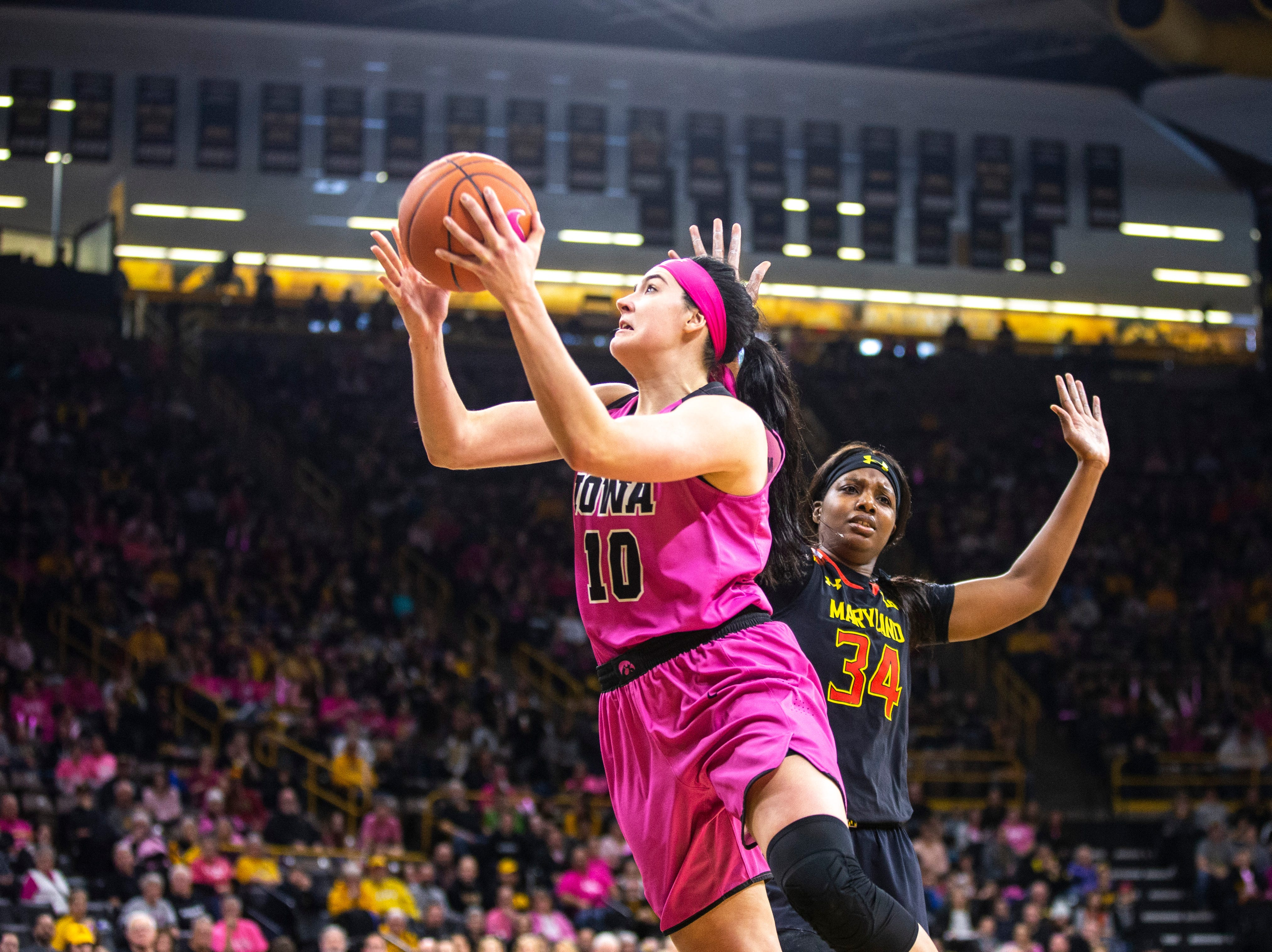 Iowa center Megan Gustafson (10) drives to the basket while Maryland center Olivia Owens (34) defends during a NCAA Big Ten Conference women's basketball game on Sunday, Feb. 17, 2019 at Carver-Hawkeye Arena in Iowa City, Iowa.