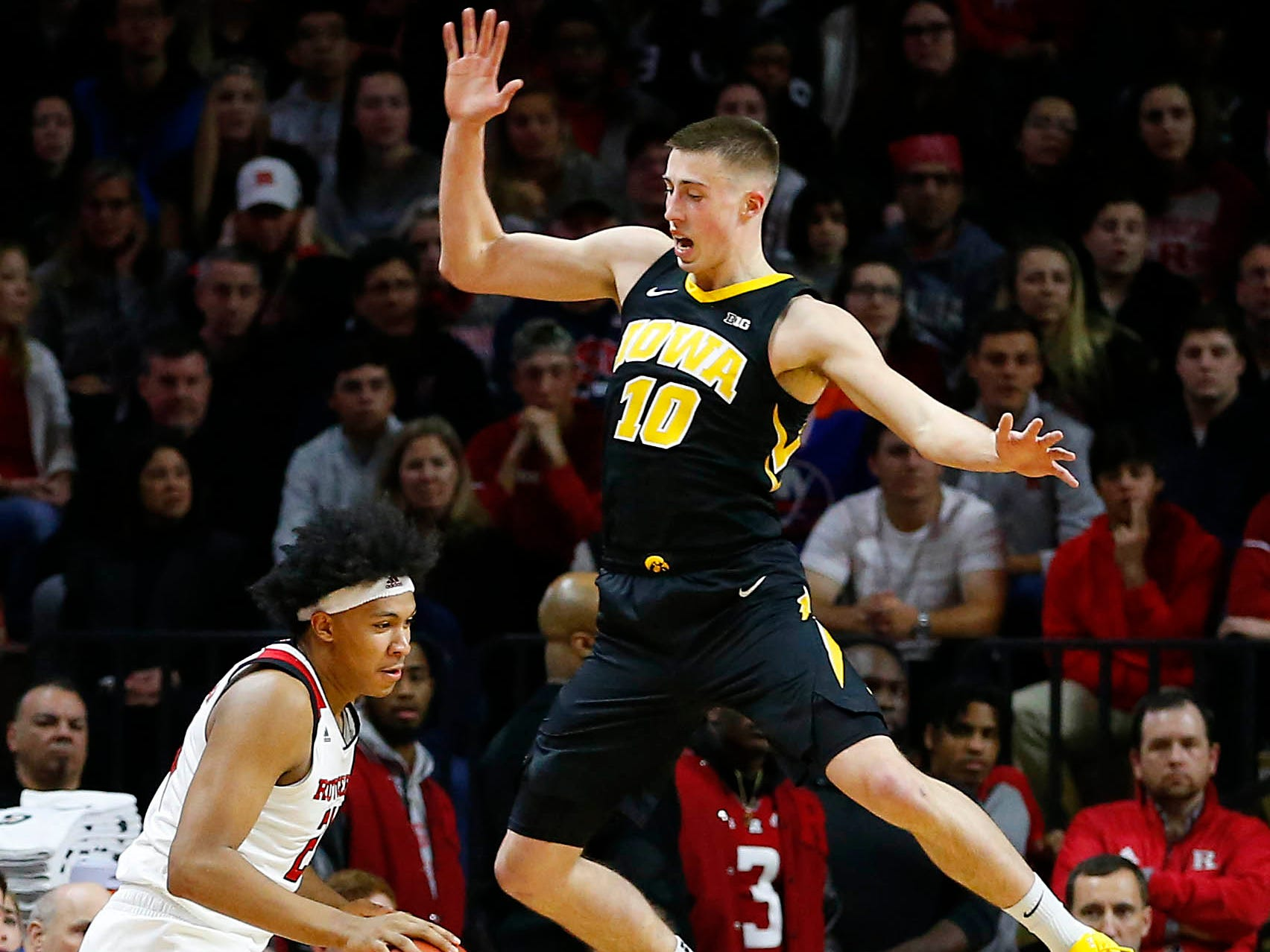 Iowa Hawkeyes guard Joe Wieskamp (10) defends against Rutgers Scarlet Knights forward Ron Harper Jr. (24) during the first half at Rutgers Athletic Center (RAC). Mandatory Credit: Noah K. Murray-USA TODAY Sports